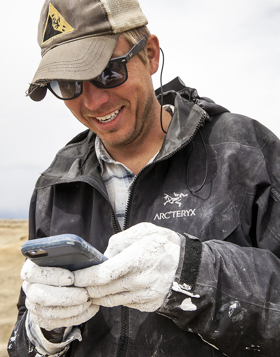 Lead Guide John Hankla playing TRUE SURF video game for iPhone while imagining Wyoming's Cretaceous coastline.