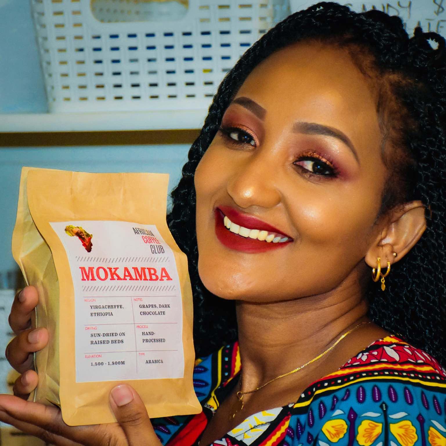 Mokamba Lady Holding Mokamba.jpg