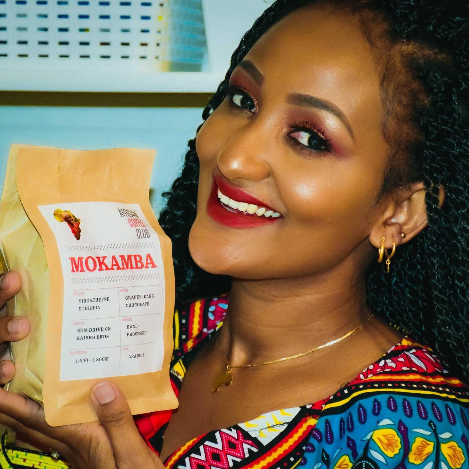 Momkamba_model_holding_bag.jpg