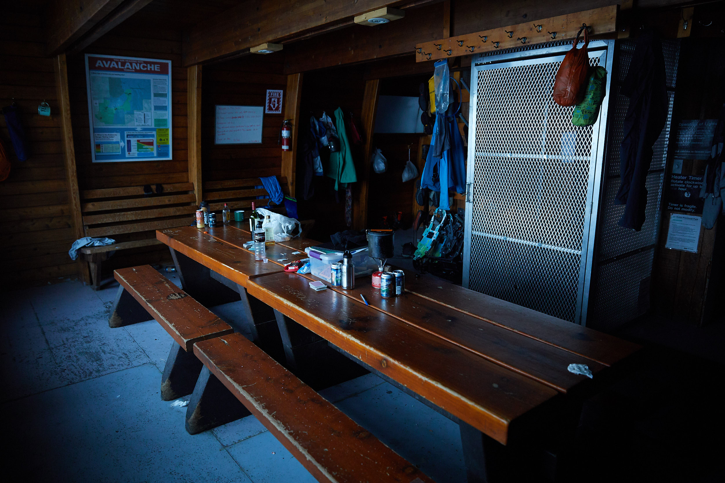 The hut has ample seating and tables for cooking and playing games.
