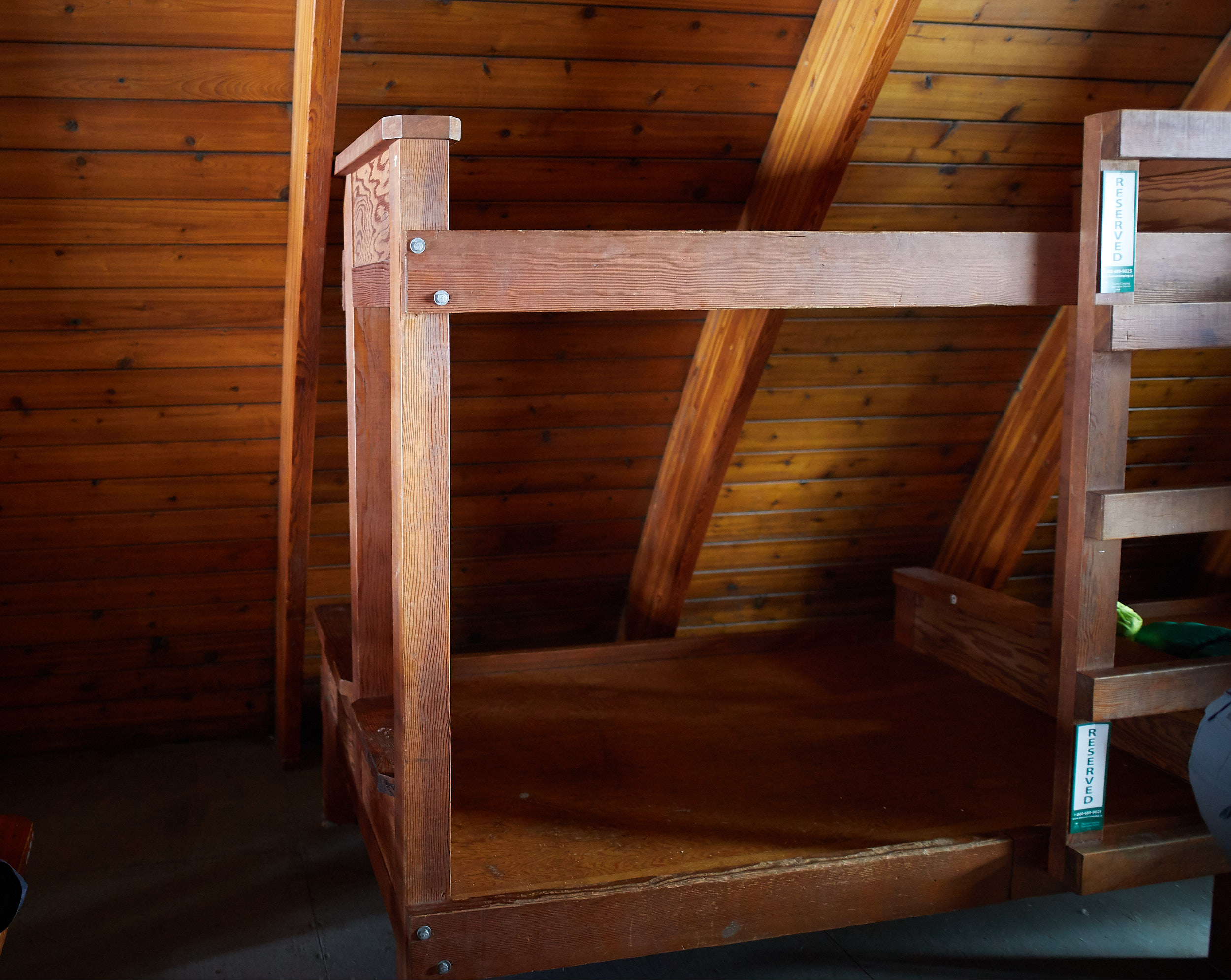 The hut is lined with bunk beds, with the bottoms being doubles and the tops being singles.