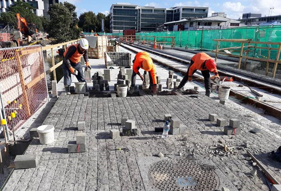 Image 3 (above):    Our paving team lay cobblestones for the new road surface on Daldy Street, near Pakenham Street West