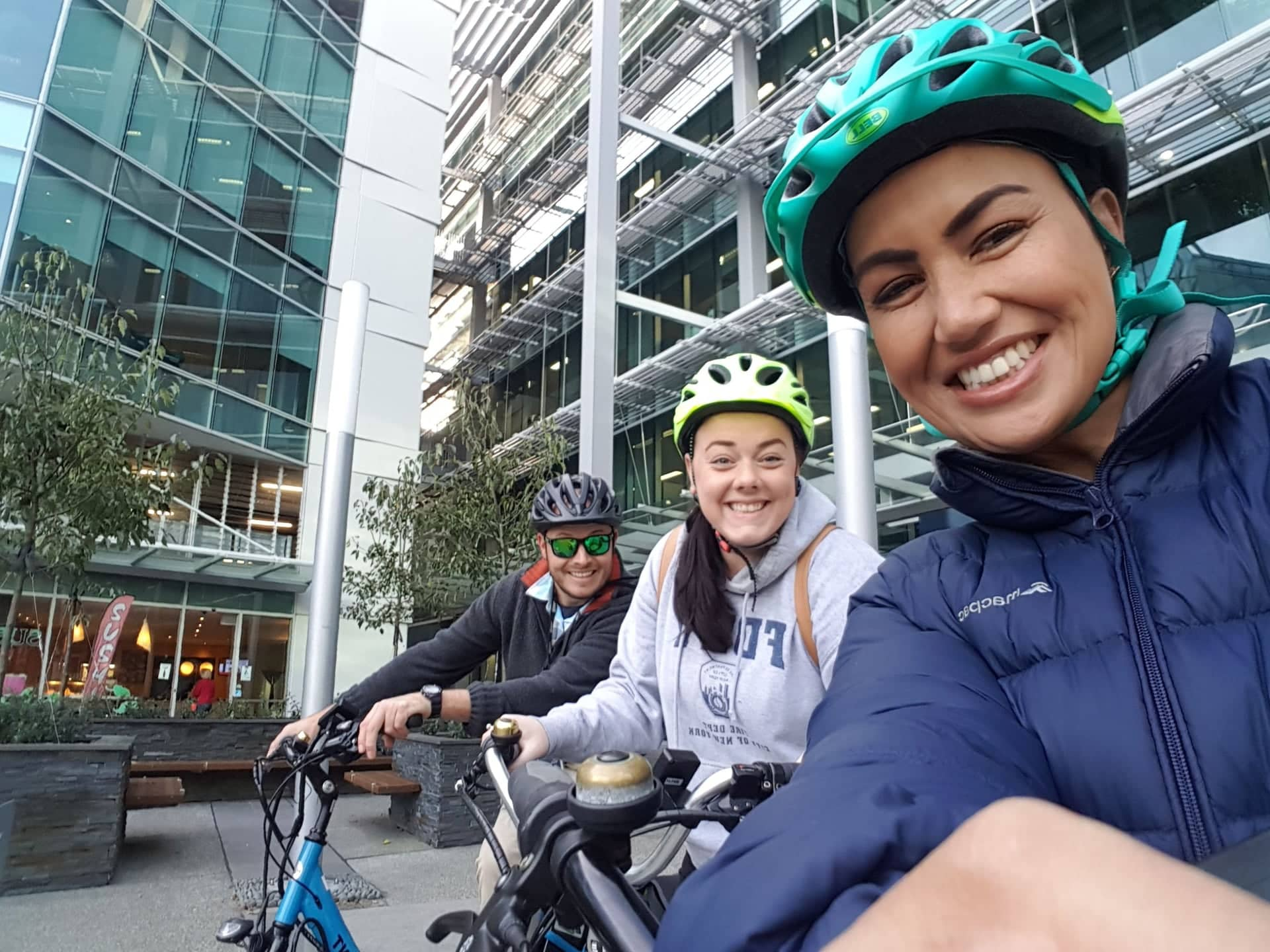 Leehane Stowers (right) and her waterfront placemaking colleagues Paul Nicoll and Charlotte Palmer, cycling through Wynyard Quarter.