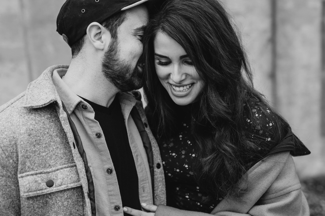 009_couple_engagement_and_laughing_black_photography_white_saint_Paul-1100x733.jpg