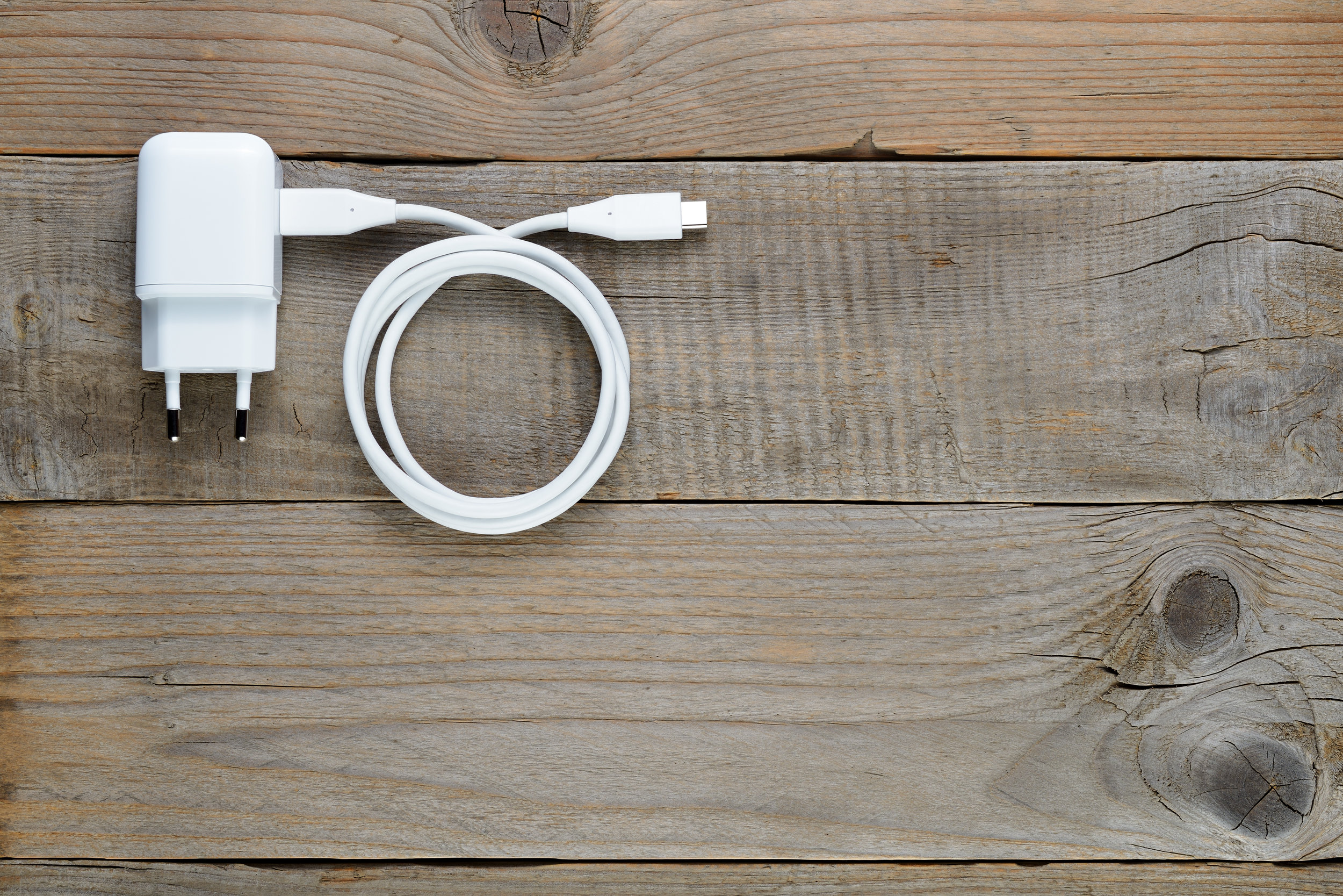 smartphone-or-tablet-charger-on-wooden-table-PSUKUE5.jpg