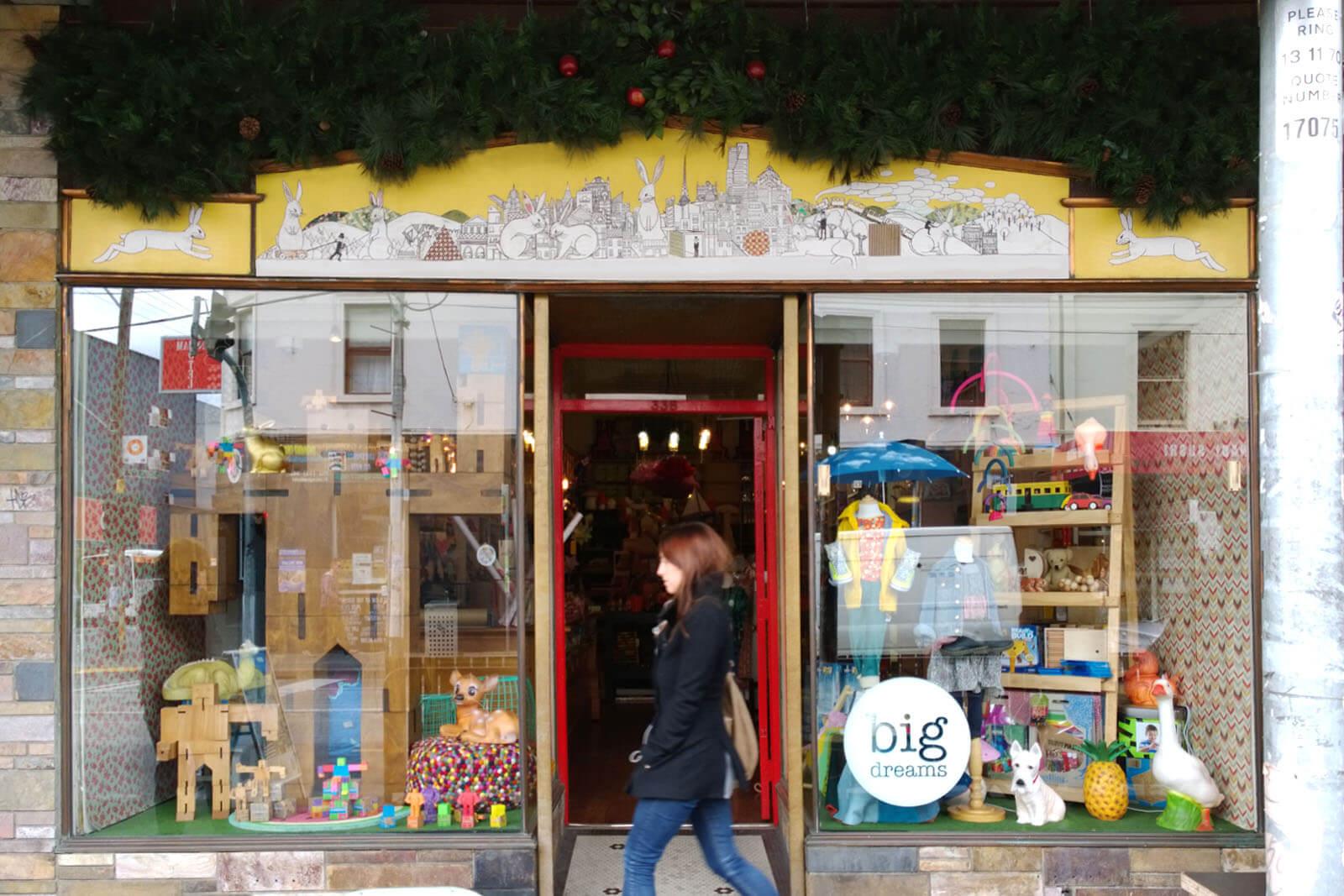 big dreams exterior shop paste-up mural, collingwood