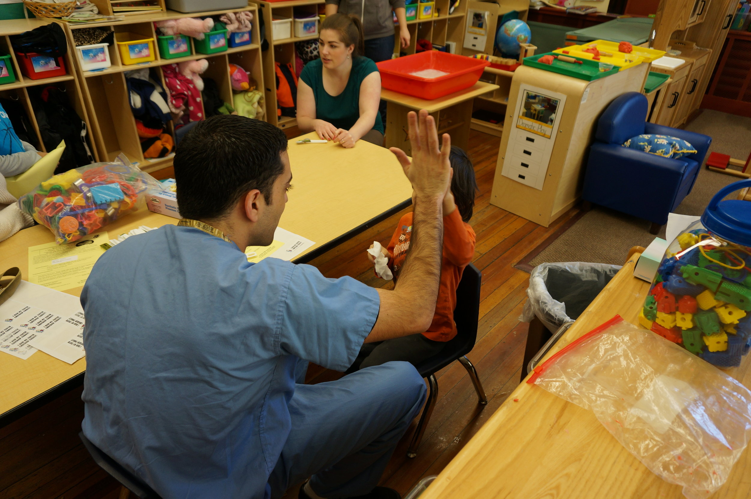 Fluoride varnish & high fives as part of an outreach program where Uconn Dental students visited head start programs to provide preventative dentistry & free oral screenings - March 2015
