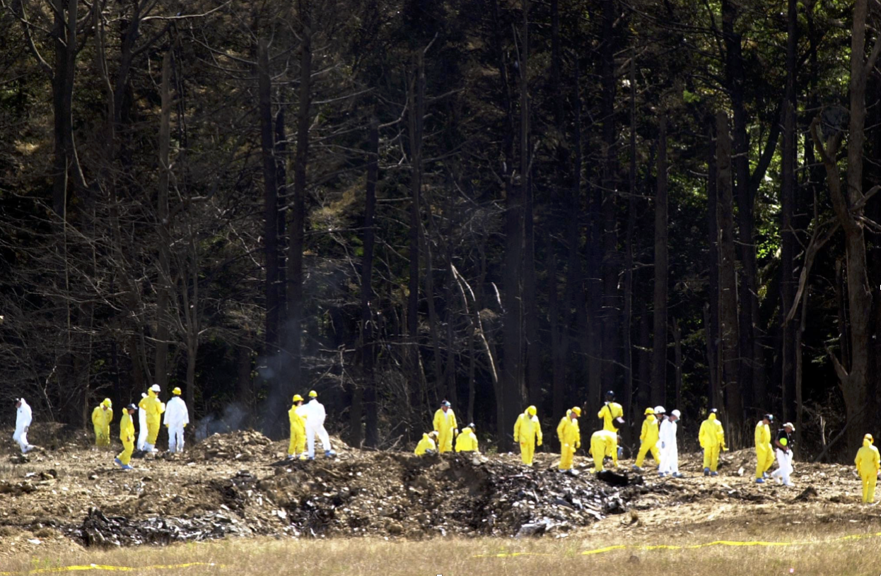 Investigators comb the debris field for the flight data recorders from United Airlines Flight 93 near Shanksville, Pennsylvania, on September 12, 2001. (Tim Shaffer/REUTERS)