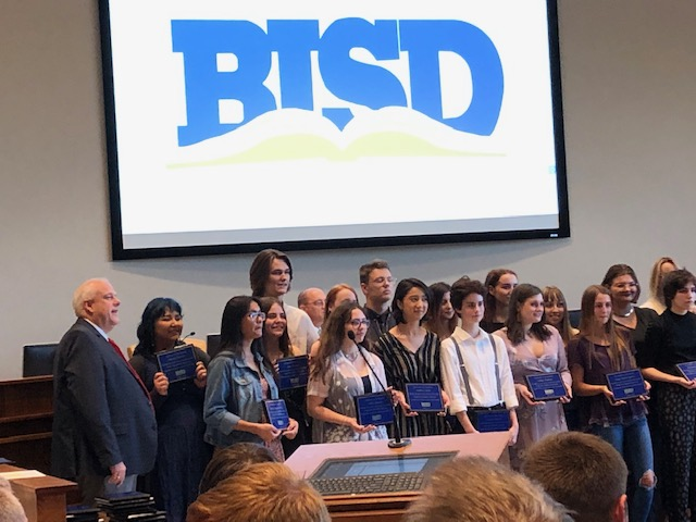 BISD Trustee Kelvin Dilks declined to perform on May 23 as Amon Carter in the new play he stars in because of his responsibility to serve on the Birdville school board. Here', he is shown (at left) with students who were honored at the meeting.