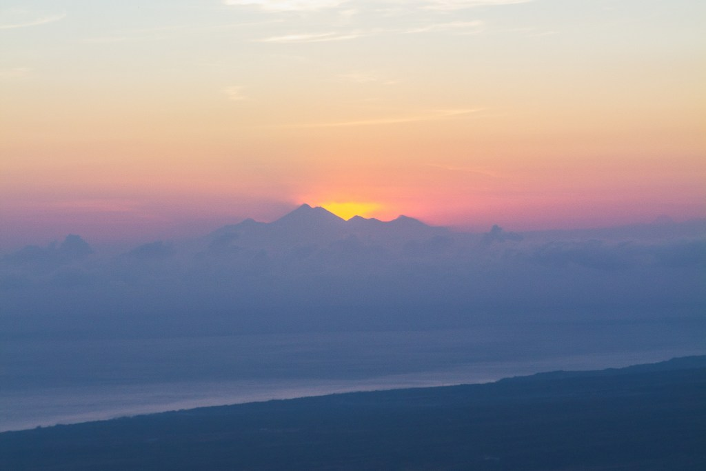The sun rising from behind Mt. Rinjani