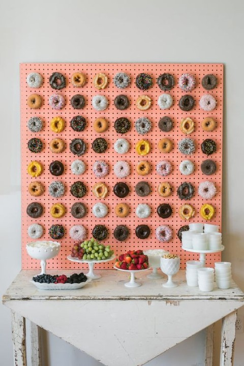 coral-colored-pegboard-wall-with-hooks-for-displaying-donuts.jpg