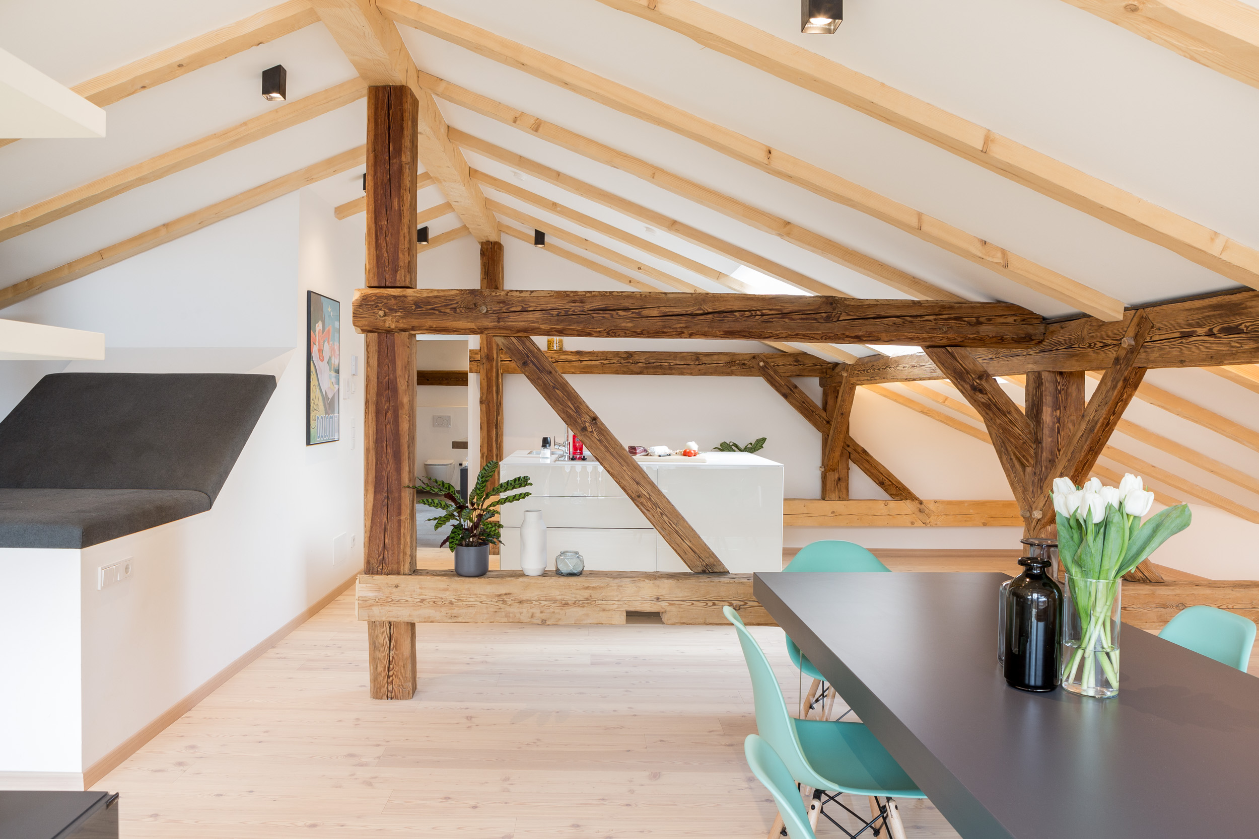 Apartment 5 - Design loft with a free-standing bathtub and private balcony overlooking a picturesque mountain landscape.