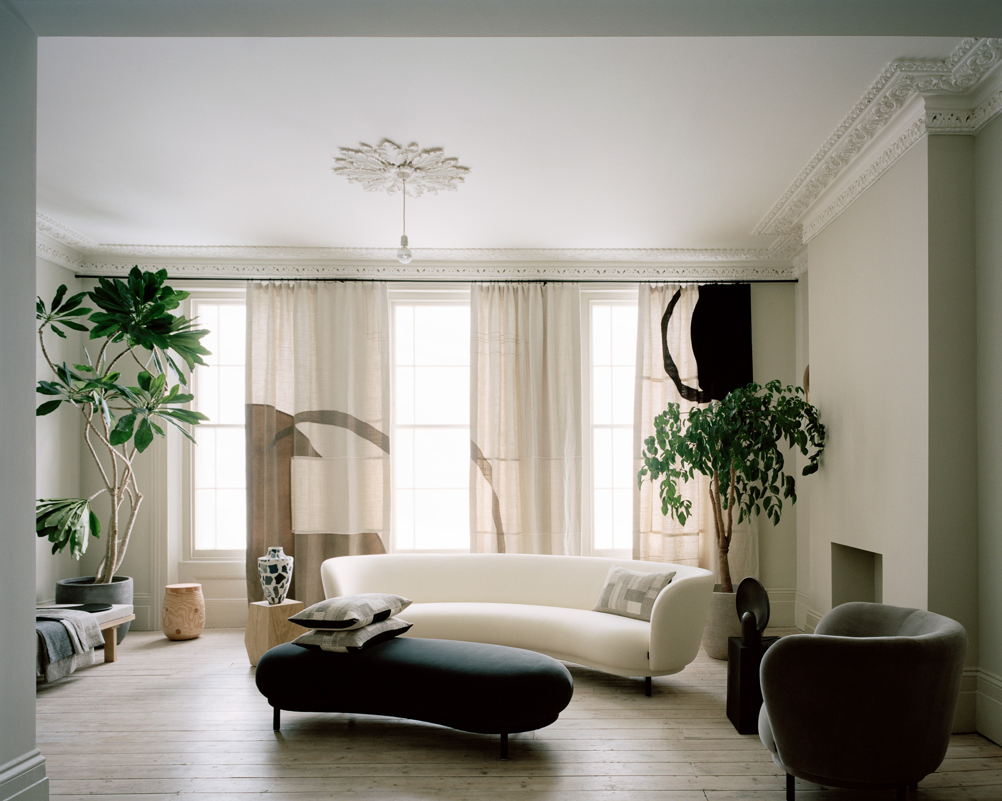 House_of_Grey_Exhibition_curved_sofa_indoor_plants.jpg