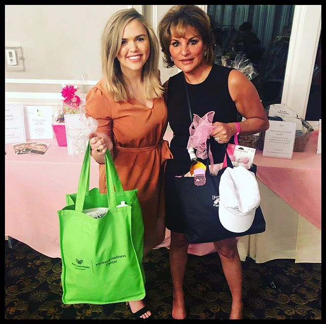 Our physician assistant Kelly and aesthetician Rima with their raffle prizes at Fashion for the Cure 💕