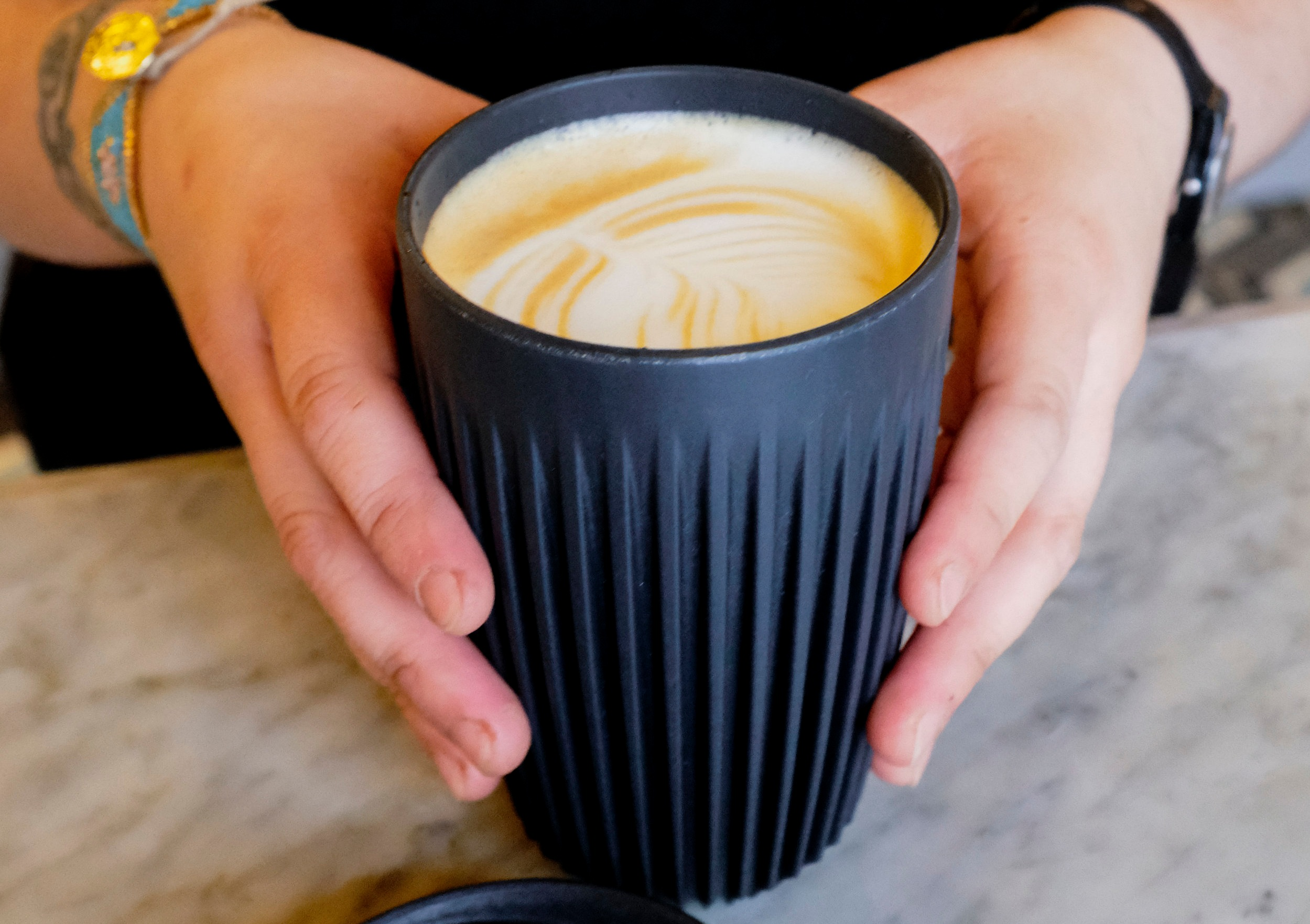 """- """"Our goal is to make it as easy as possible for our customers to consume less. The key was finding a cup that everyone will want to use regularly. The Huskee Cups have a great design, easy to clean and to drink from. Plus, they are made out of an organic byproduct of the coffee milling process, and so are extra eco-friendly."""" Taylor Bloom, Think Coffee Barista, 8th Avenue"""