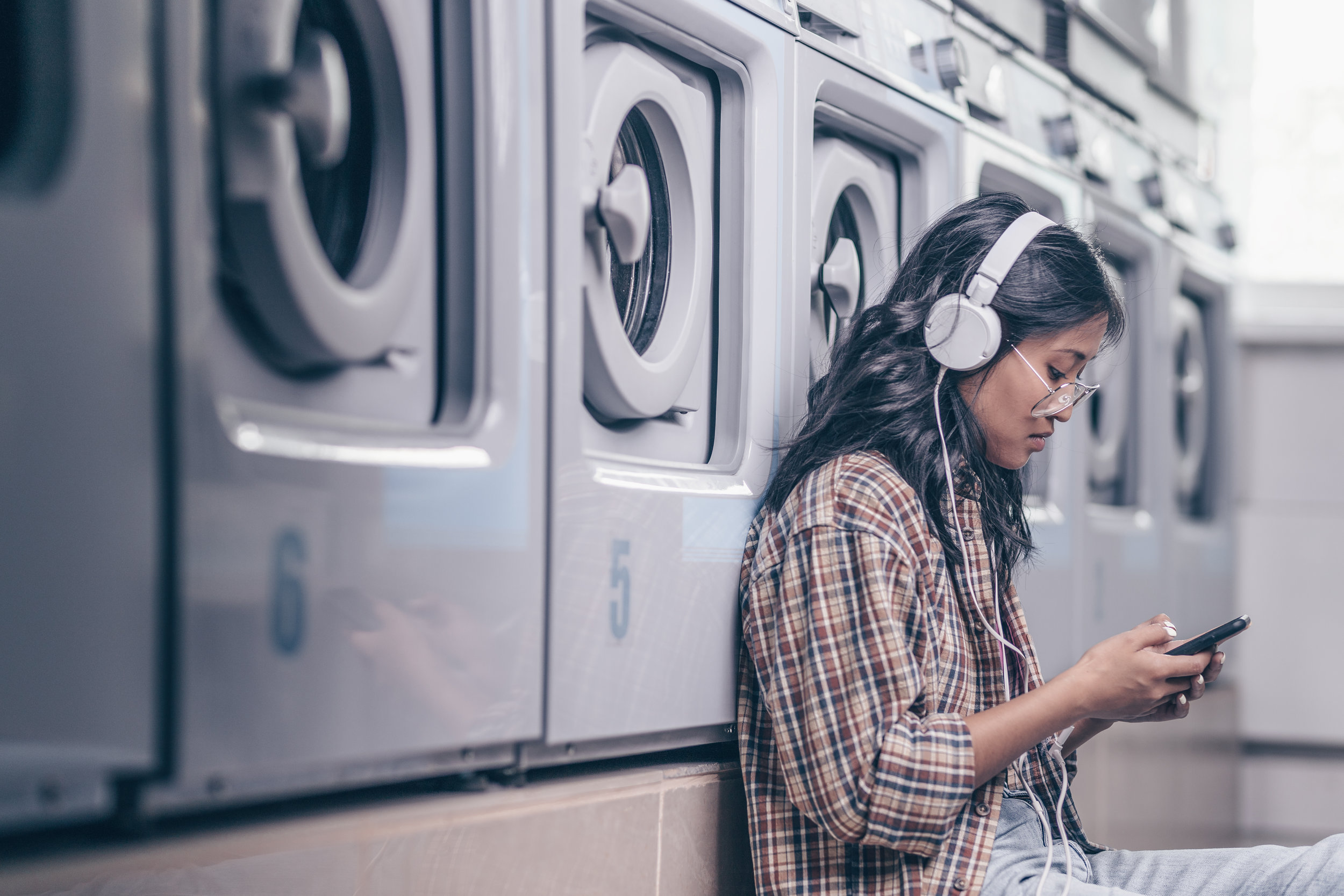woman doing laundrylistening to Ear Training on the Run