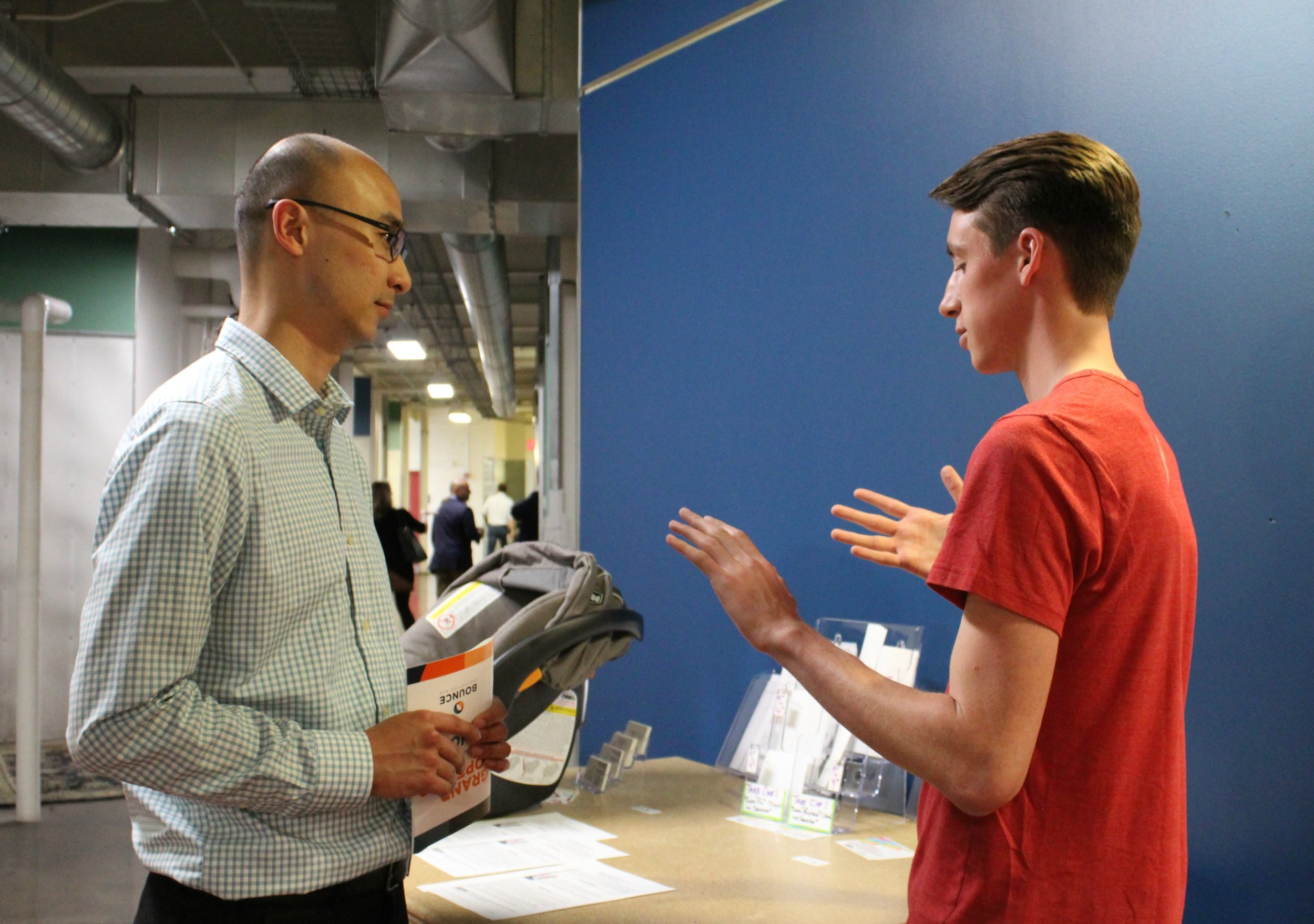 Joe explains the science behind our dry adhesive material to a visitor during the open house.