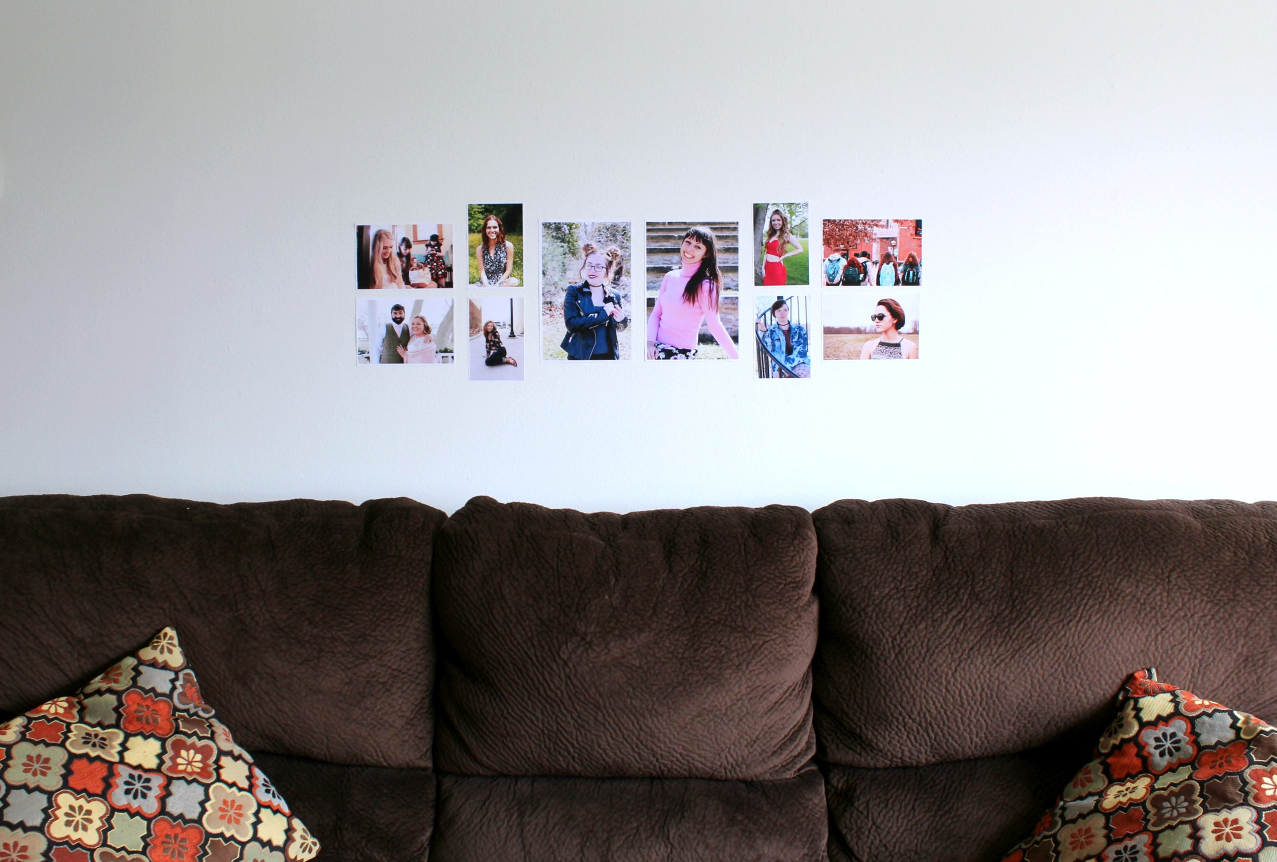 My first arrangement of photos filled more horizontal space than my subsequent arrangements, and I felt like that made it blend too much with the horizontal line of the couch.