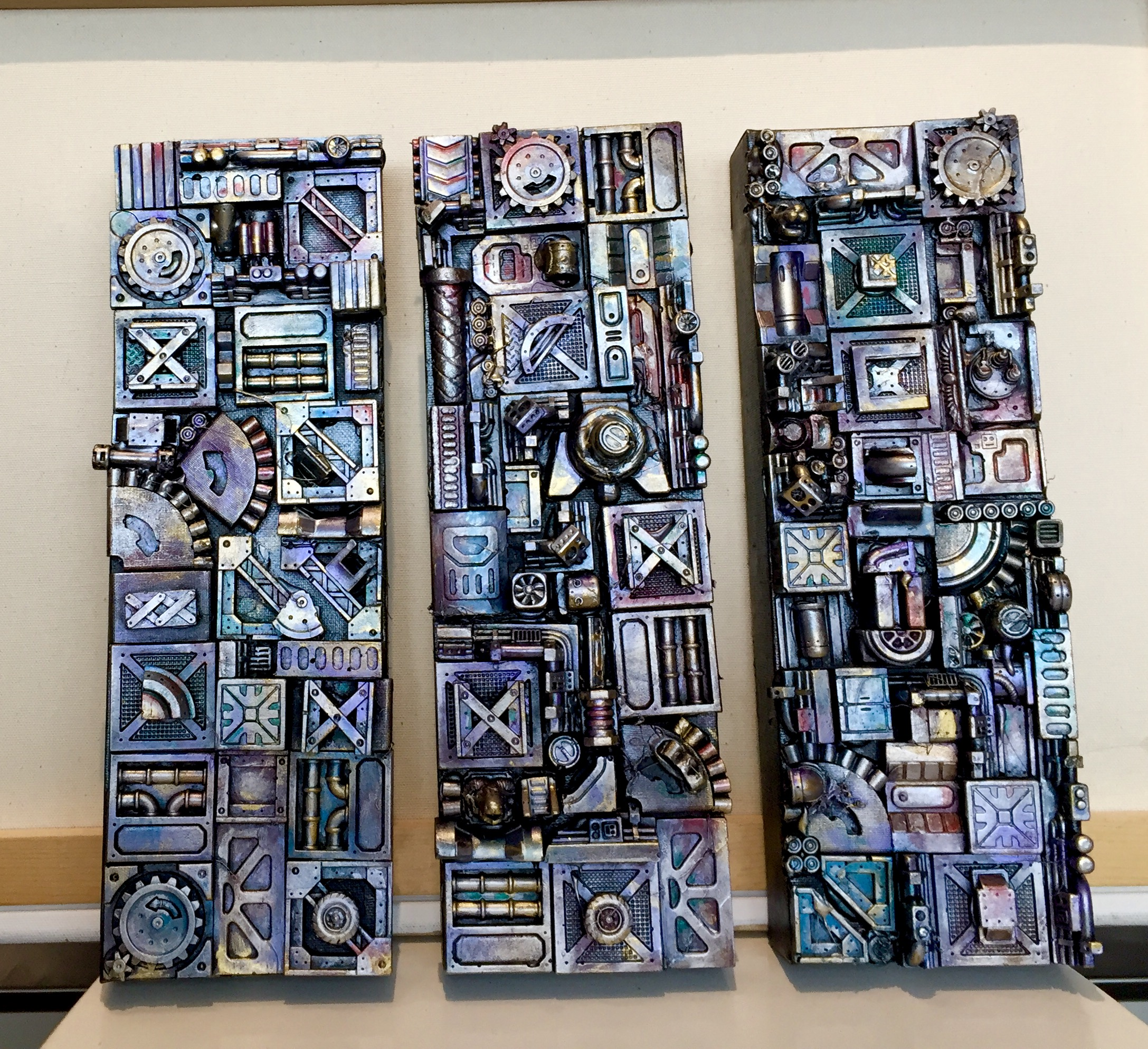 "Clockwork II. 3D mixed media on canvas  Acrylic on die stone, 3 panels - each panel is 4"" x 12""   SOLD"