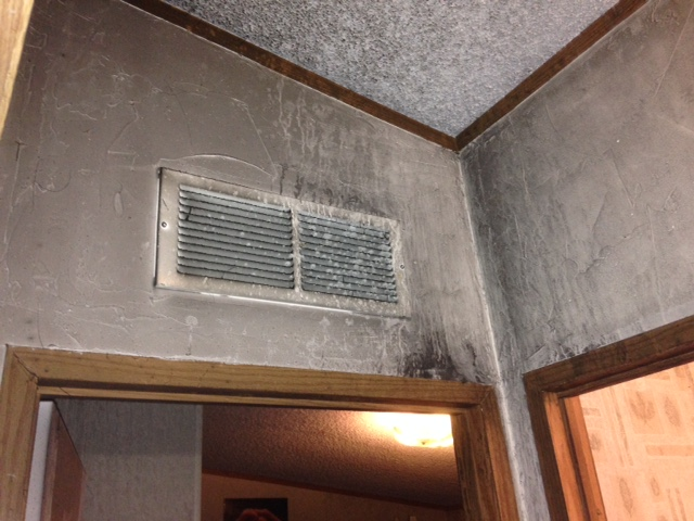 fire damage to interior walls and ceiling of home
