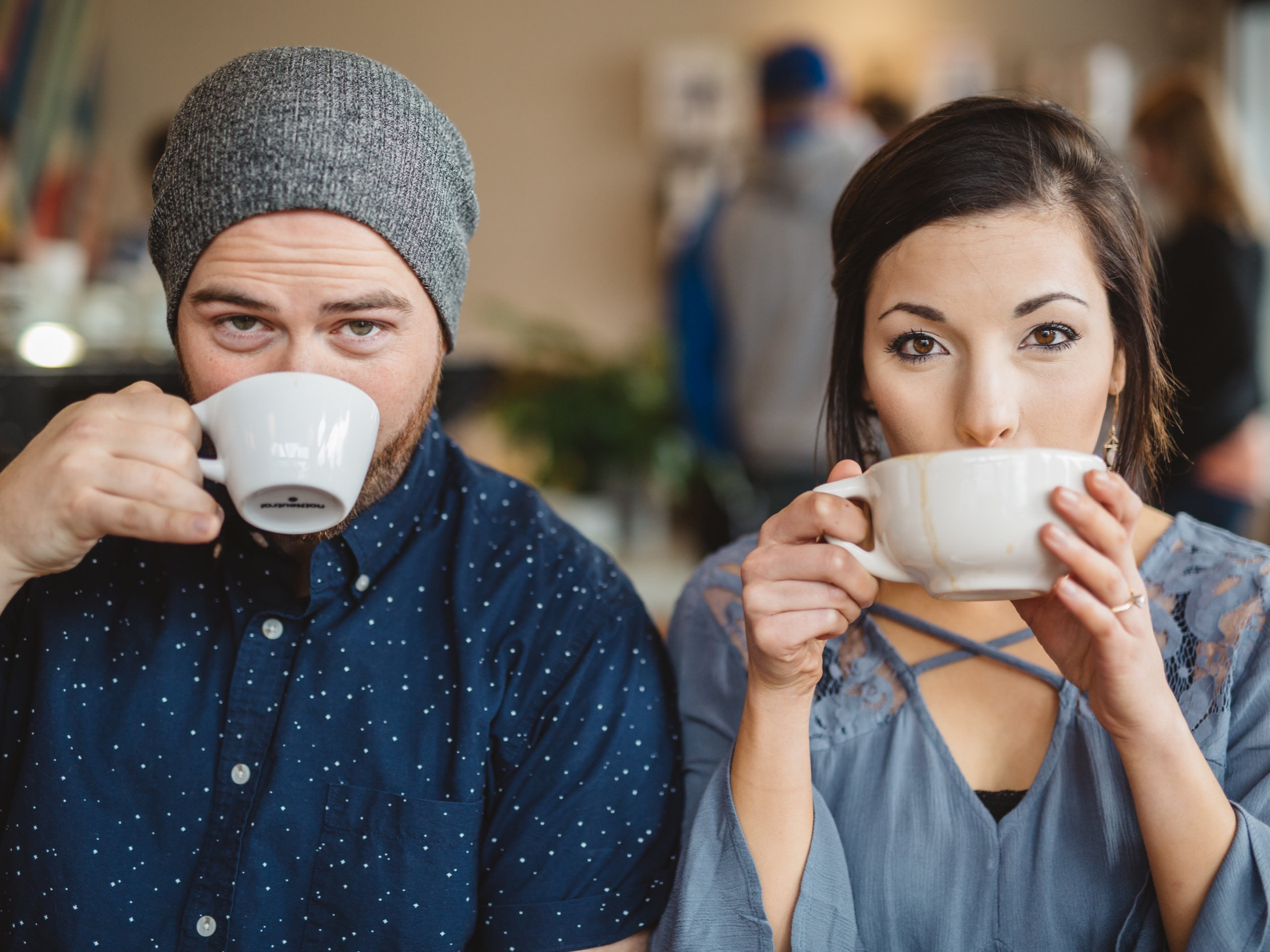 young-couple-drinks-coffee-together-while-sitting-an-a-coffee-shop_t20_a8jKPY.jpg
