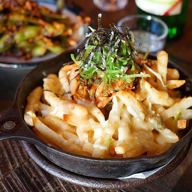 Our disco fries are so good, they've even been featured on @delish. Crispy skinny fries with copious amounts of pulled pork, charred cheese, kimchi, scallions, and nori. What's not to love?! 🤤 #mokbar