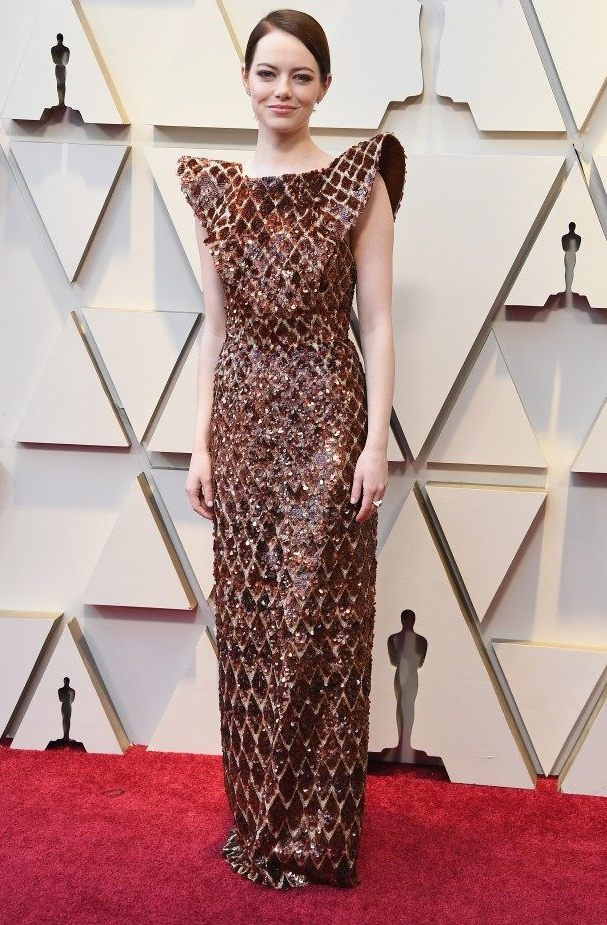 Emma Stone - Gah. This girl can do no wrong. The shoulders are so sharp, the hair, slick but easy, and that rich burnt rust color got a perfect contrast in a little dazzling metallic. It was a great choice for her, though I do wish the hem had been handled a bit differently, as it's pooling a bit too much in this photo for my taste.