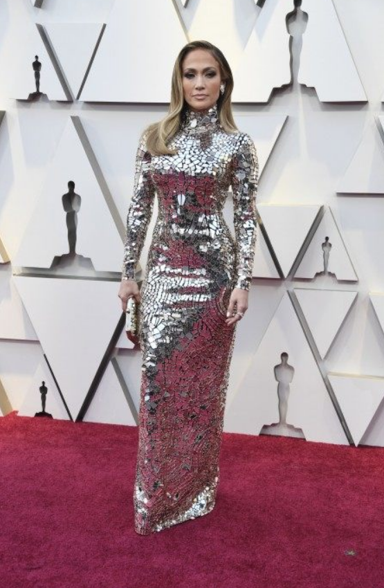 """J. Lo - So yes, this is a disco ball. It is just a disco ball. Some will say this isn't """"fashion"""" or not quite the look at the oscars. It's pretty straightforward, but who can literally reflect the sun like Jennifer Lopez and be gorgeously painted into this shinny wonder? She is a star, and this is a star's dress at the Oscars."""
