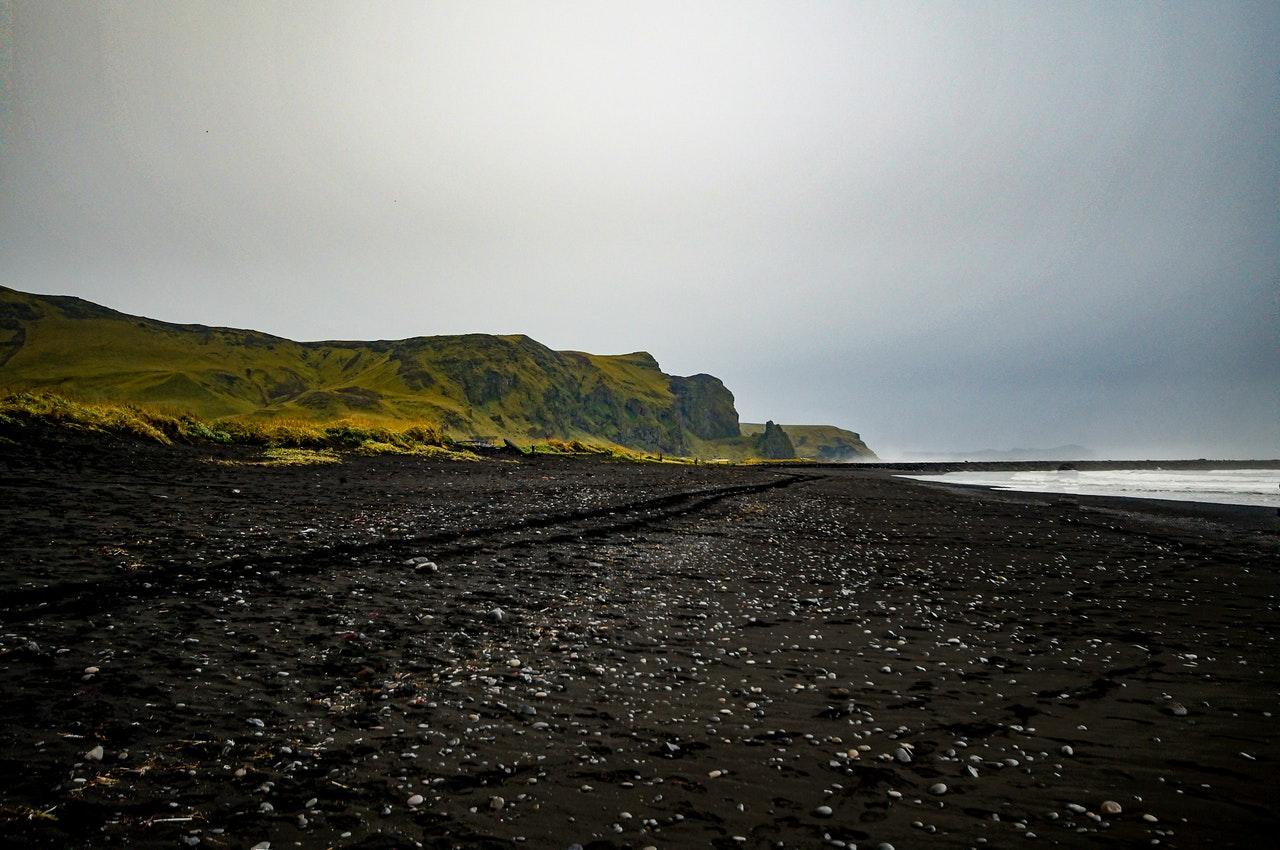 beach-black-sand-beach-clouds-318420.jpg