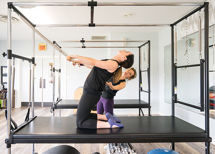 Thigh Stretch Pilates Cadillac