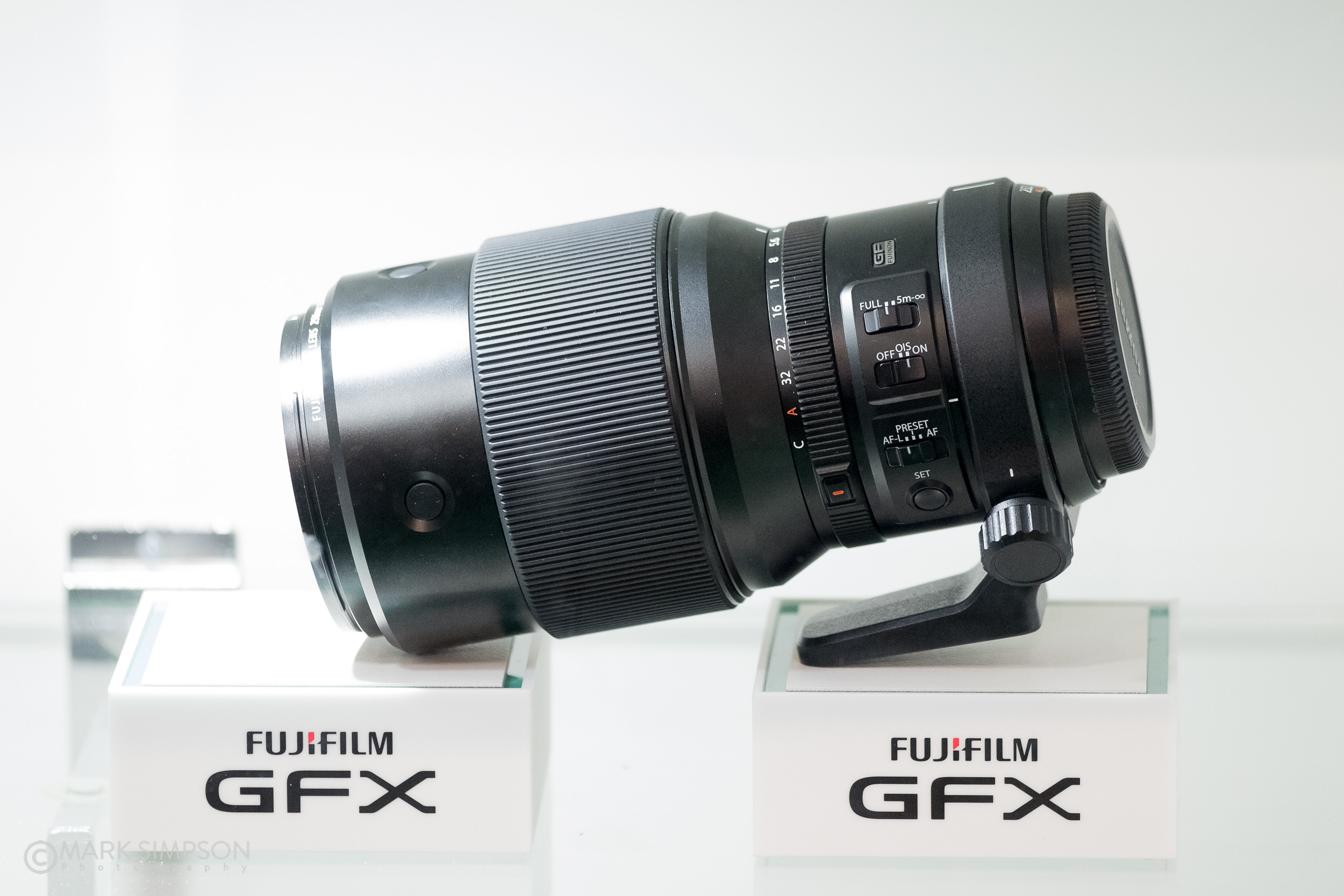 The forthcoming Fujinon GF 250mm f/4 R LM OIS WR for the GFX was tucked away in the corner of a display cabinet. (FujiFilm X-H1, Fujinon 50-140mm f2.8 WR OIS XF, 1/105 @ f/2.8, ISO 3200)