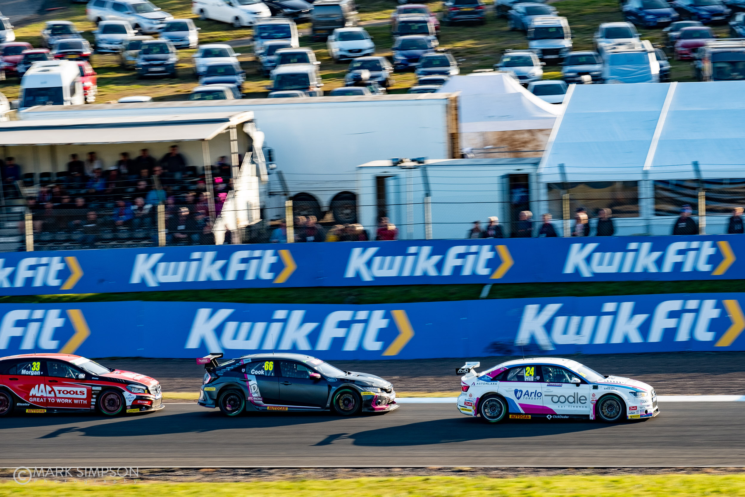 Race 3 action as Jake Hill (Audi S3) leads Josh Cook (Honda Civic FK8) and Adam Morgan (Mercedes Benz A-Class) into Taylor's Hairpin.