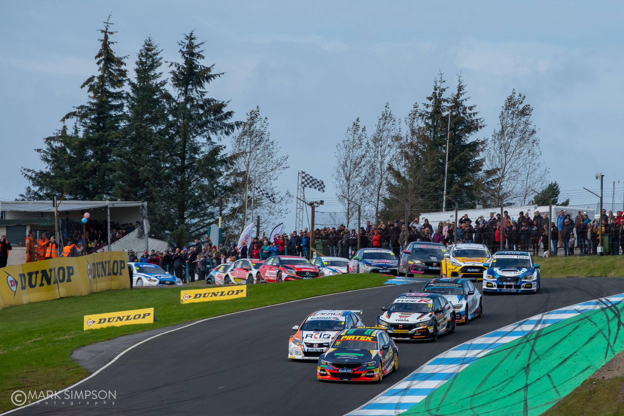 Andrew Jordan (BMW 330i) M Sport leads the field through Duffus Dip and into Leslie's.