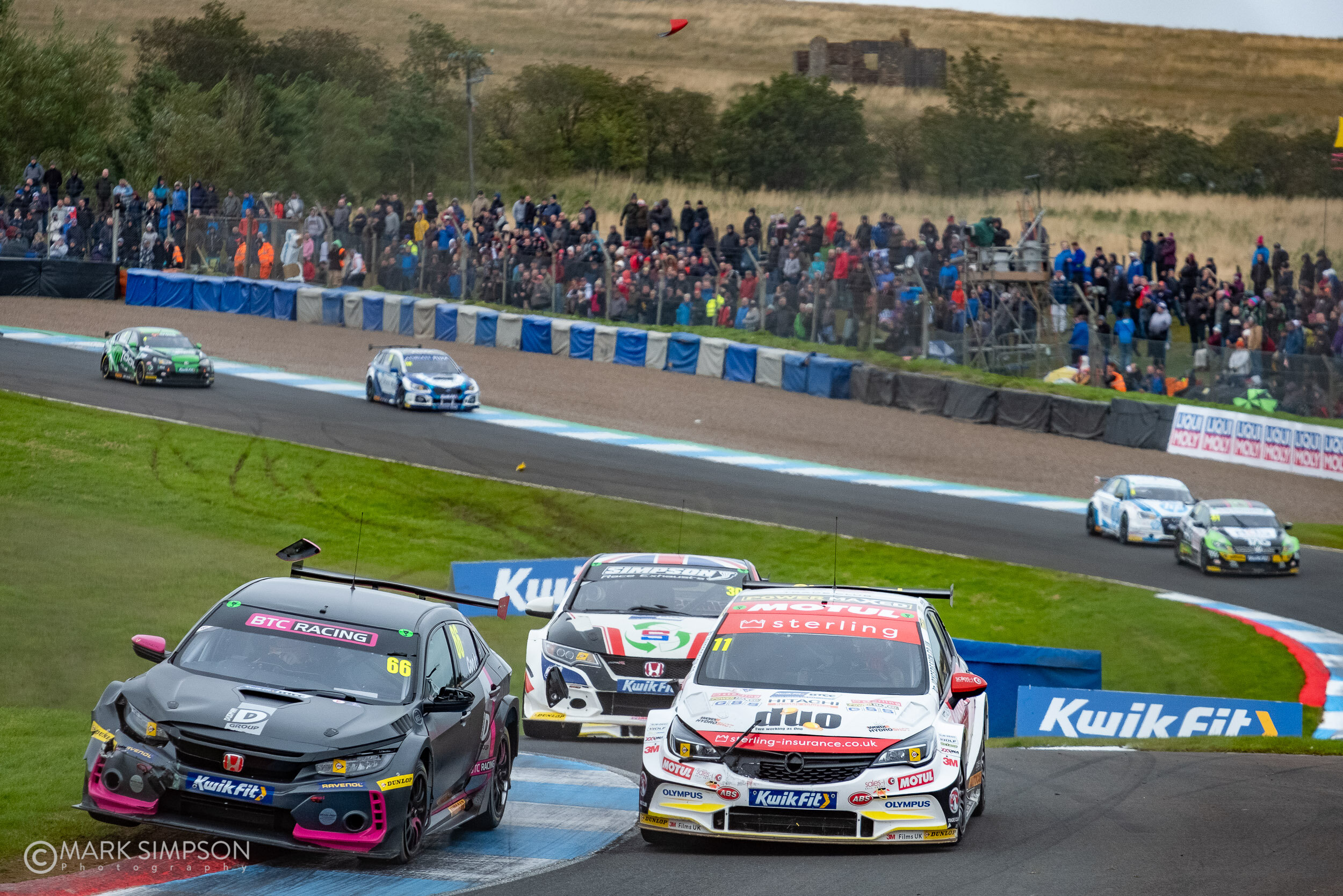 Door mirrors fly as Josh Cook (Honda Civic FK8) muscles his was past the Vauxhall Astra of Jason Plato.