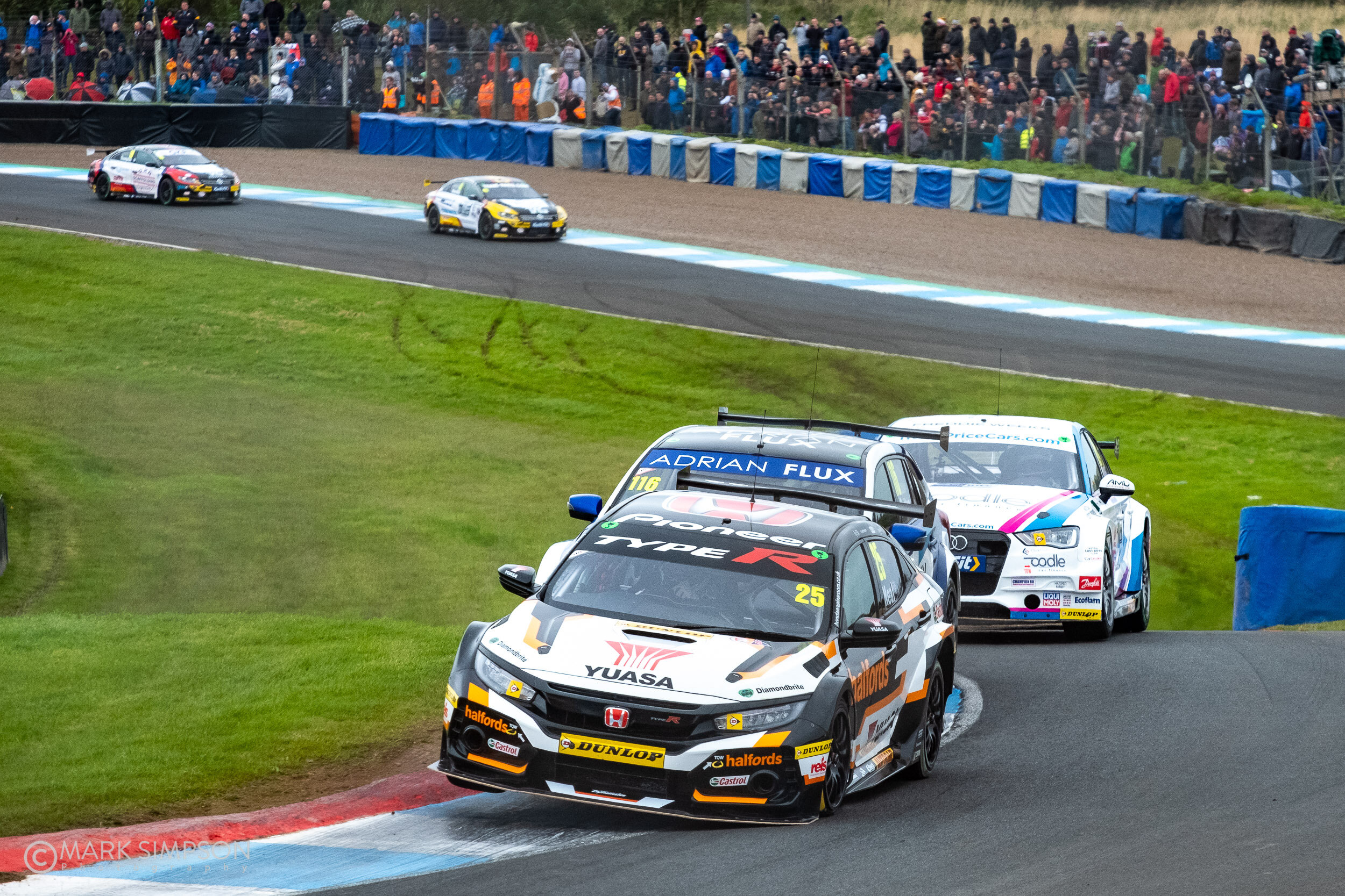 The frought battle between Matt Neal (Honda Civic Type R FK8) and Ash Sutton (Subaru Levorg) ended in retirement for both drivers.
