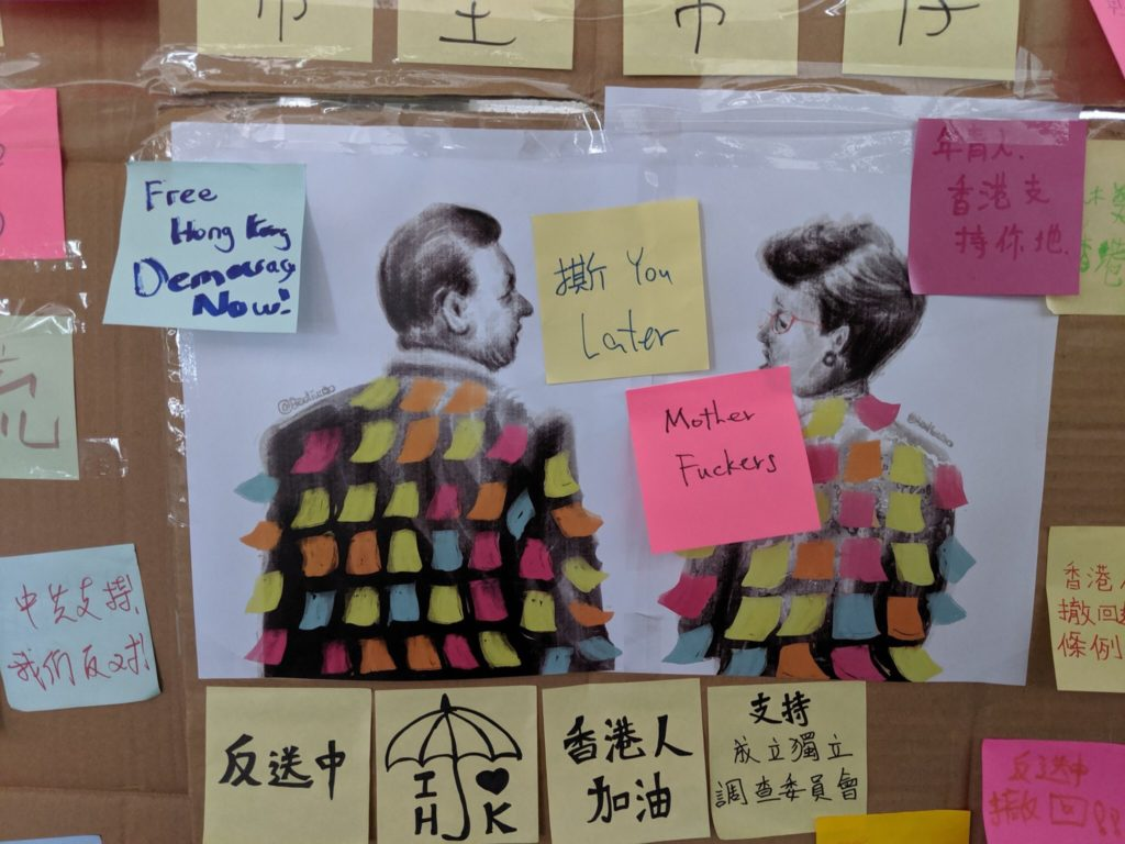 "Illustration of Chinese president Xi Jinping and Hong Kong chief executive Carrie Lam covered with Post-Its by Badiucao ends up on one of the ""Lennon walls"" in Hong Kong. Courtesy of Badiucao."