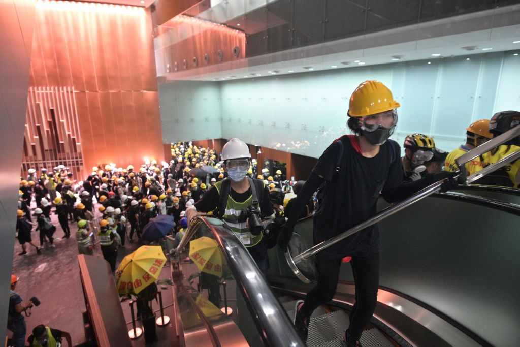 Protesters break into the government headquarters in Hong Kong on July 1, 2019, on the 22nd anniversary of the city's handover from Britain to China after successfully smashing their way through reinforced glass windows. Photo: ANTHONY WALLACE/AFP/Getty Images