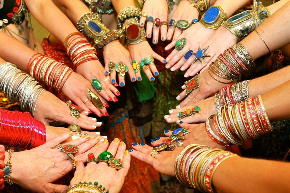 Belly dancers put their jewelry adorned hands together