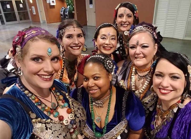 Troupe members take a selfie before a performance