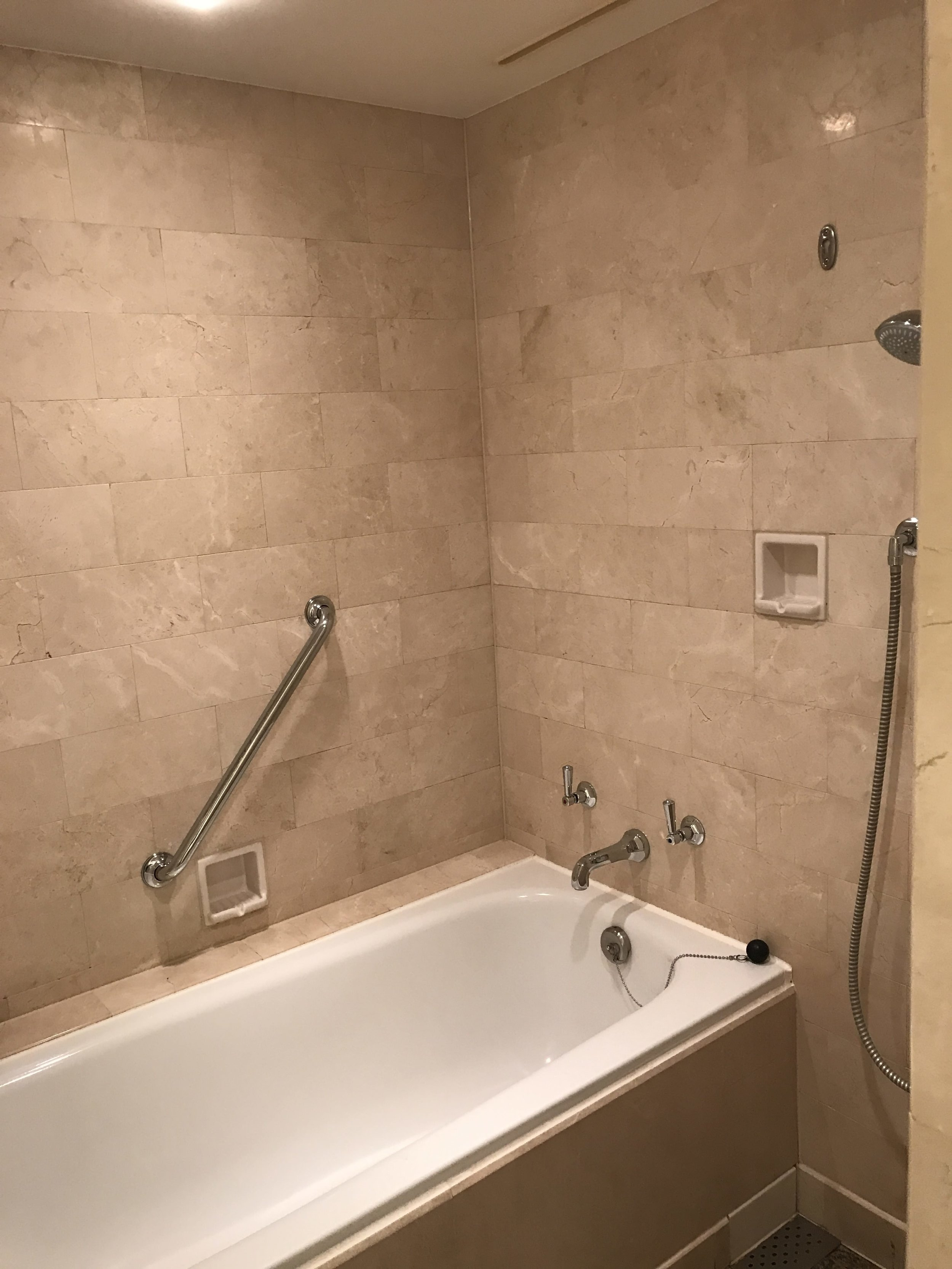 Tub without curtain. Didn't get a picture of the separate shower