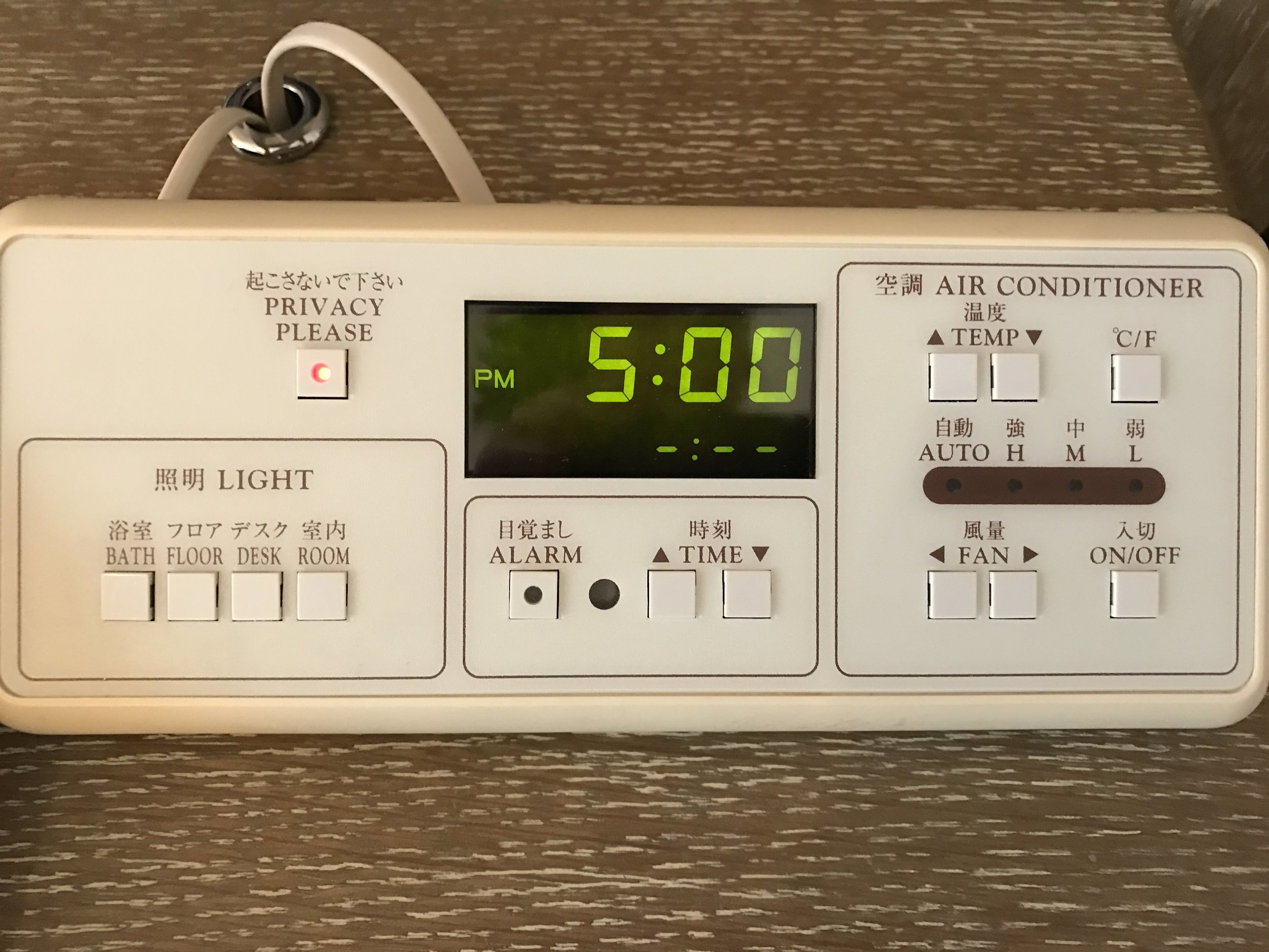Close up of room controls. It controls the lights, air conditioner, room service light, and alarm clock.