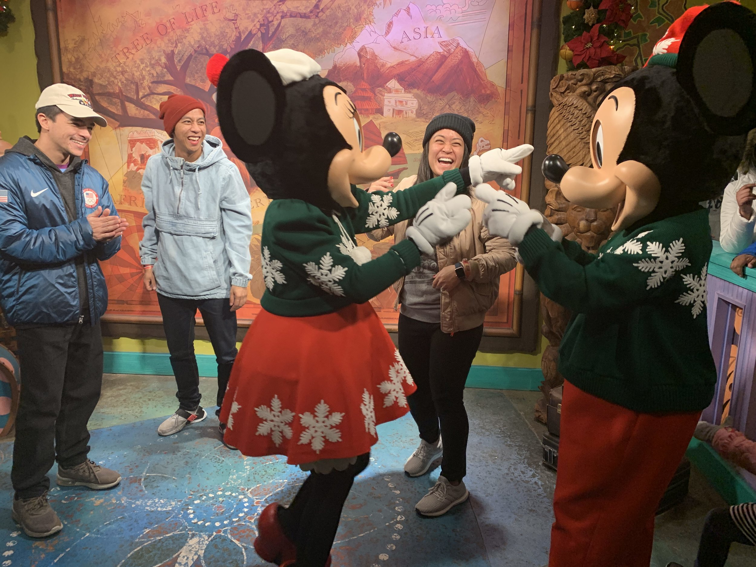 Mickey and Minnie pointing at my beanie gesturing that it was like Mickey's