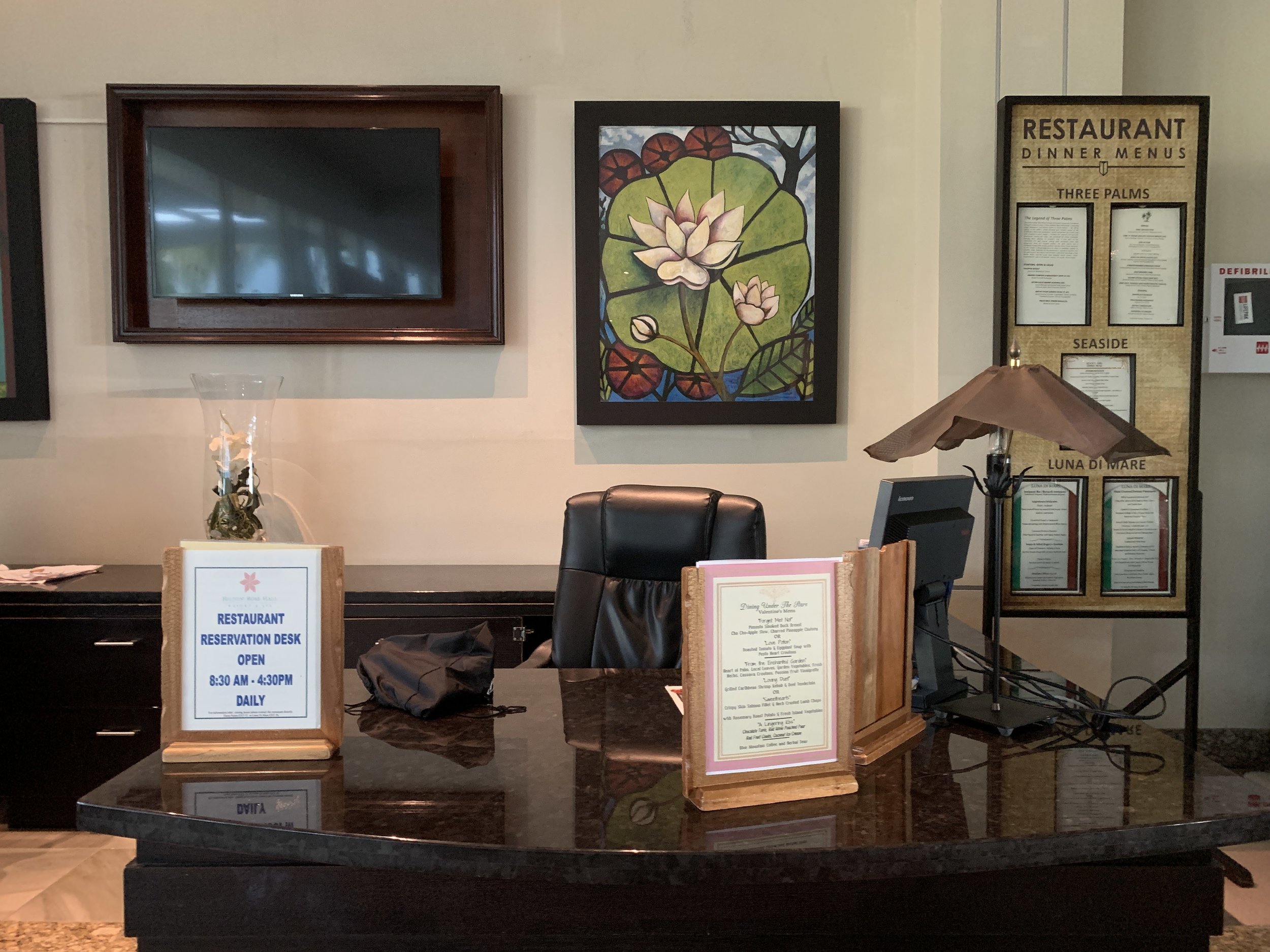 Closer look at the Dinner Reservations desk with operating hours - 8:30am-4:30pm daily
