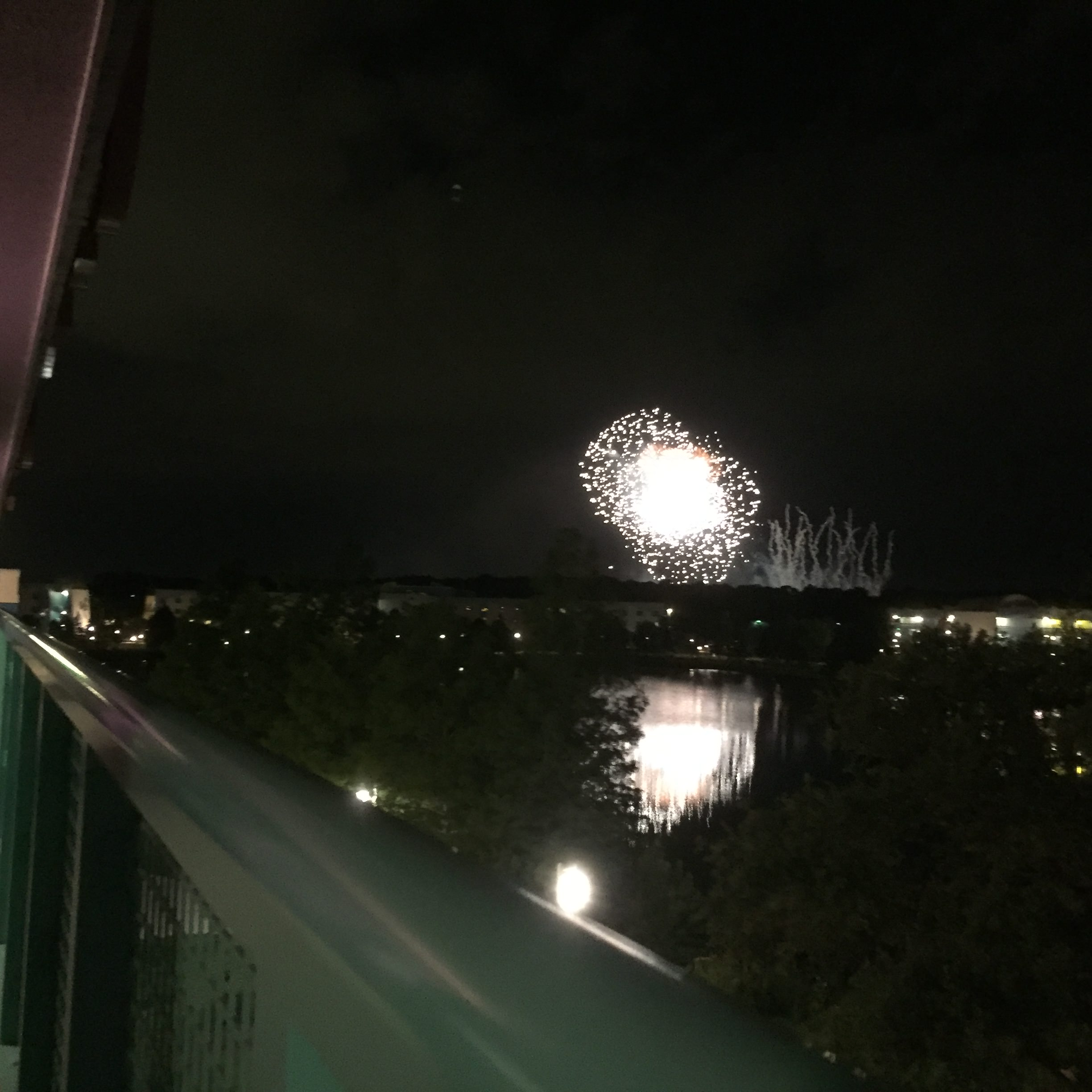 Epcot Fireworks from a 4th floor lake view room at Disney's Pop Century Resort.