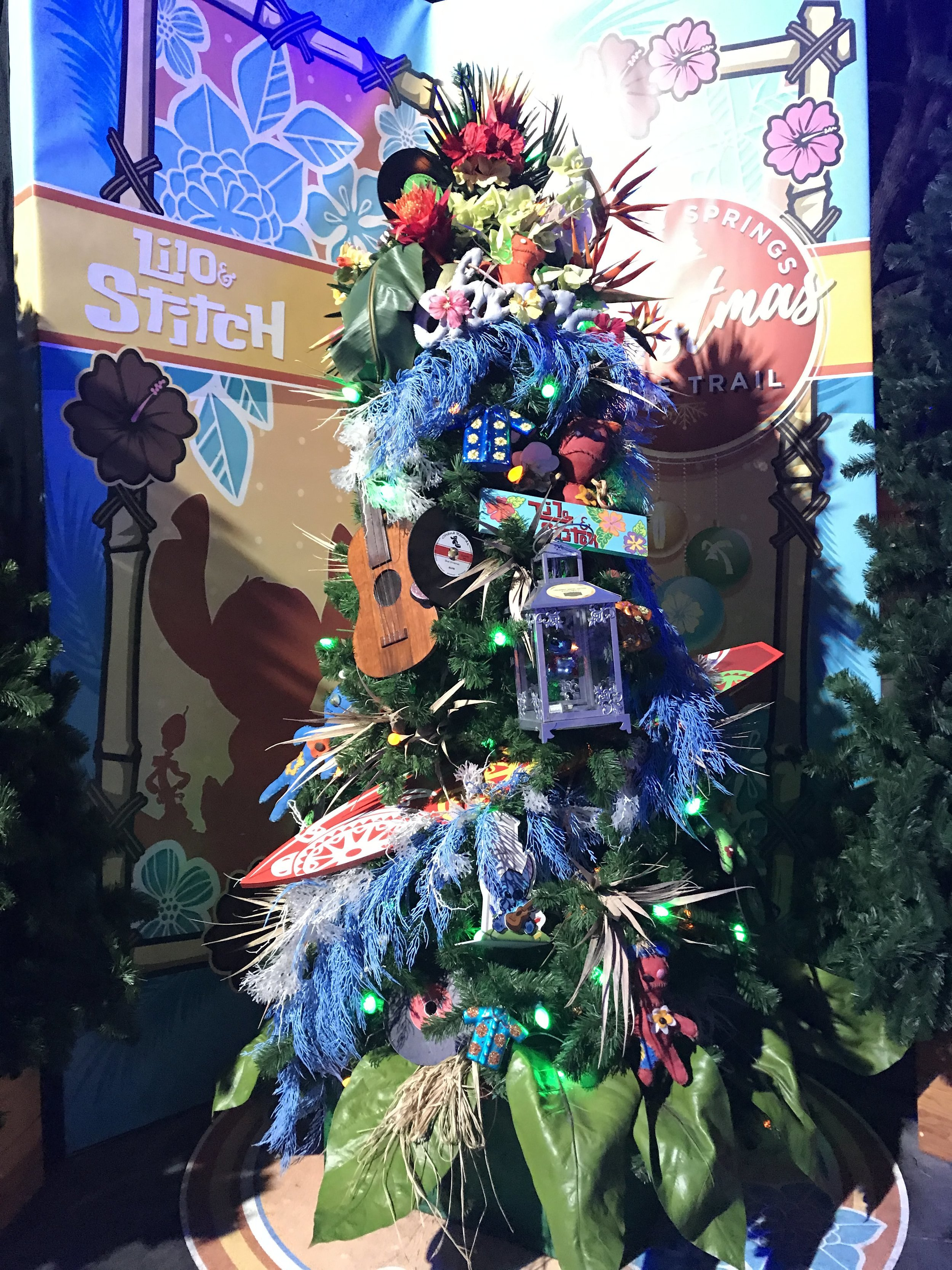 Lilo and Stitch tree. Love the grass skirt on the bottom. Such a nice touch