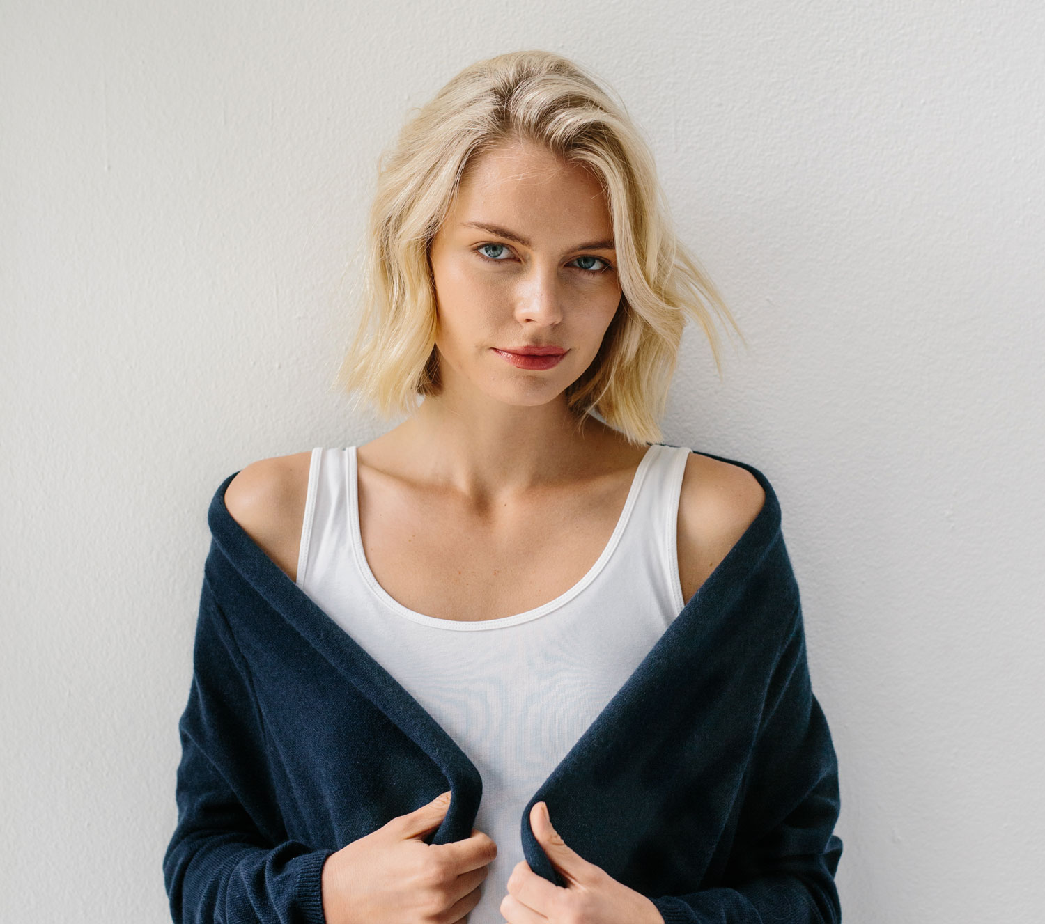 woman wearing navy cashmere wrap over yoga top
