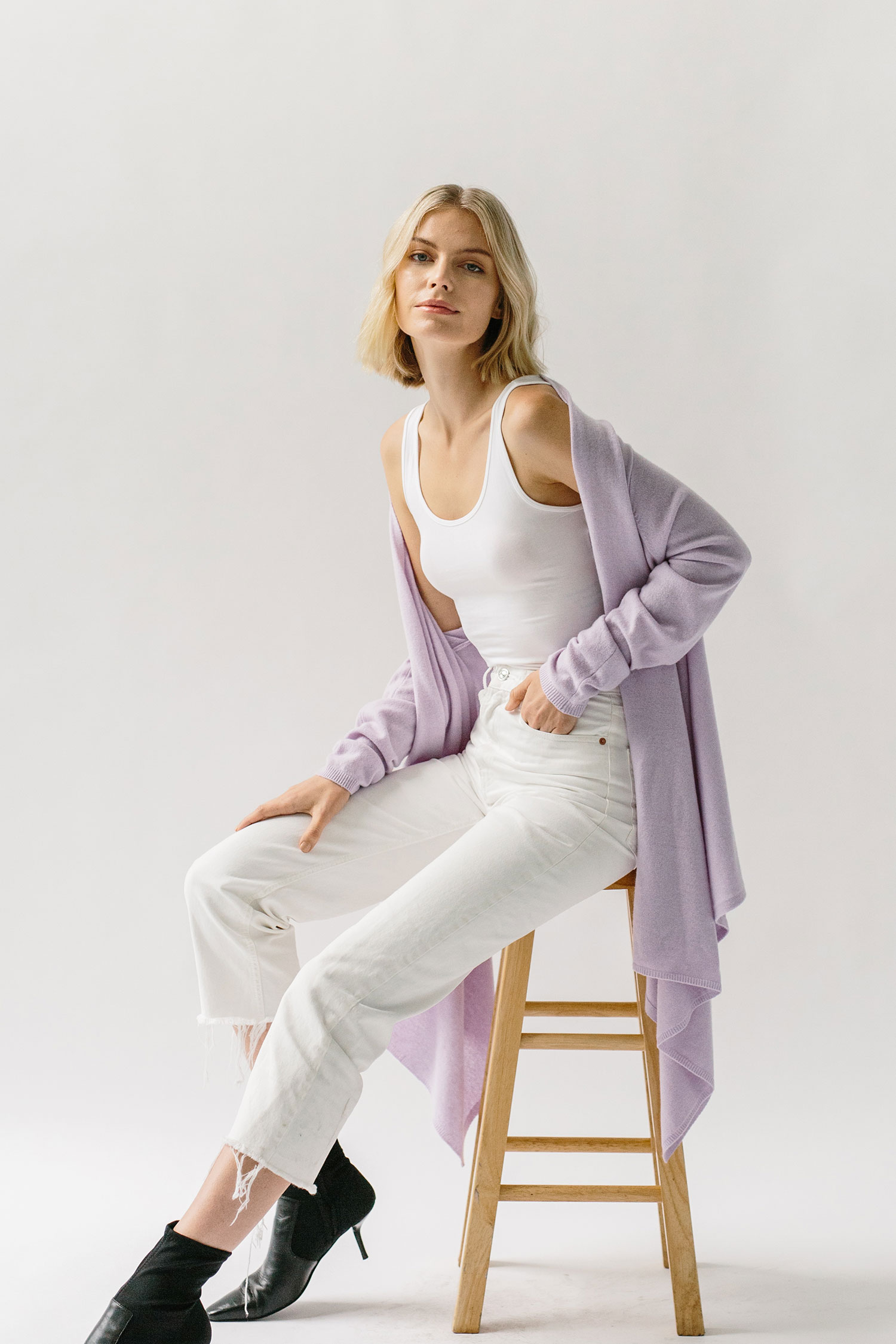 woman wearing lavender cashmere wrap sweater
