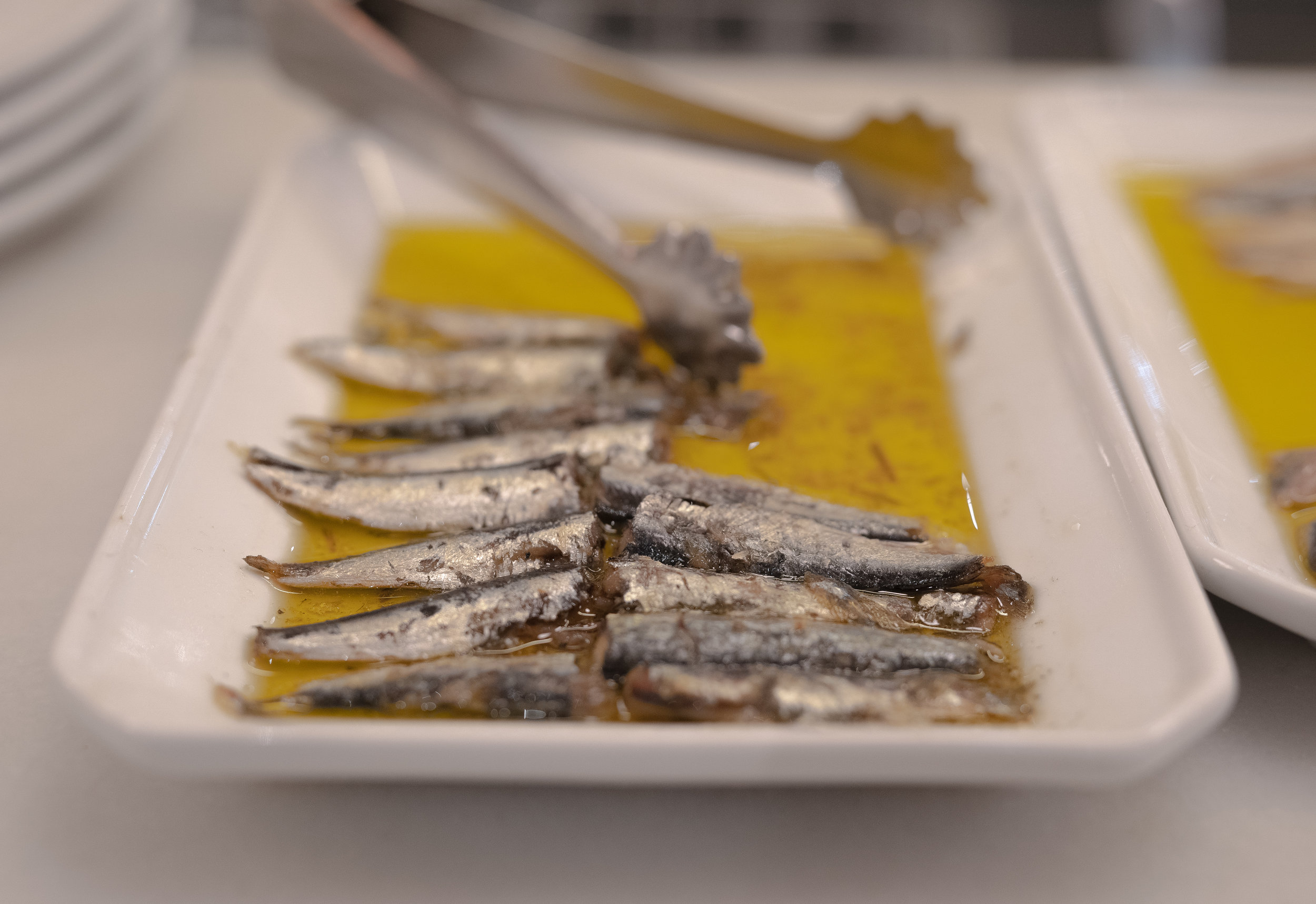 From the friends you make and teaching experience, to the traveling, learning Spanish, and EATING  sobre todo  - you will not be the same person when you go back home. For example, the untrained eye may see  aceite de oliva  with fish in the picture above. But auxiliares de conversación extranjeros wonder… could they be   sardinas   ?    boquerones   ?    anchoas   ?    bonito   ?    ventresca   ?