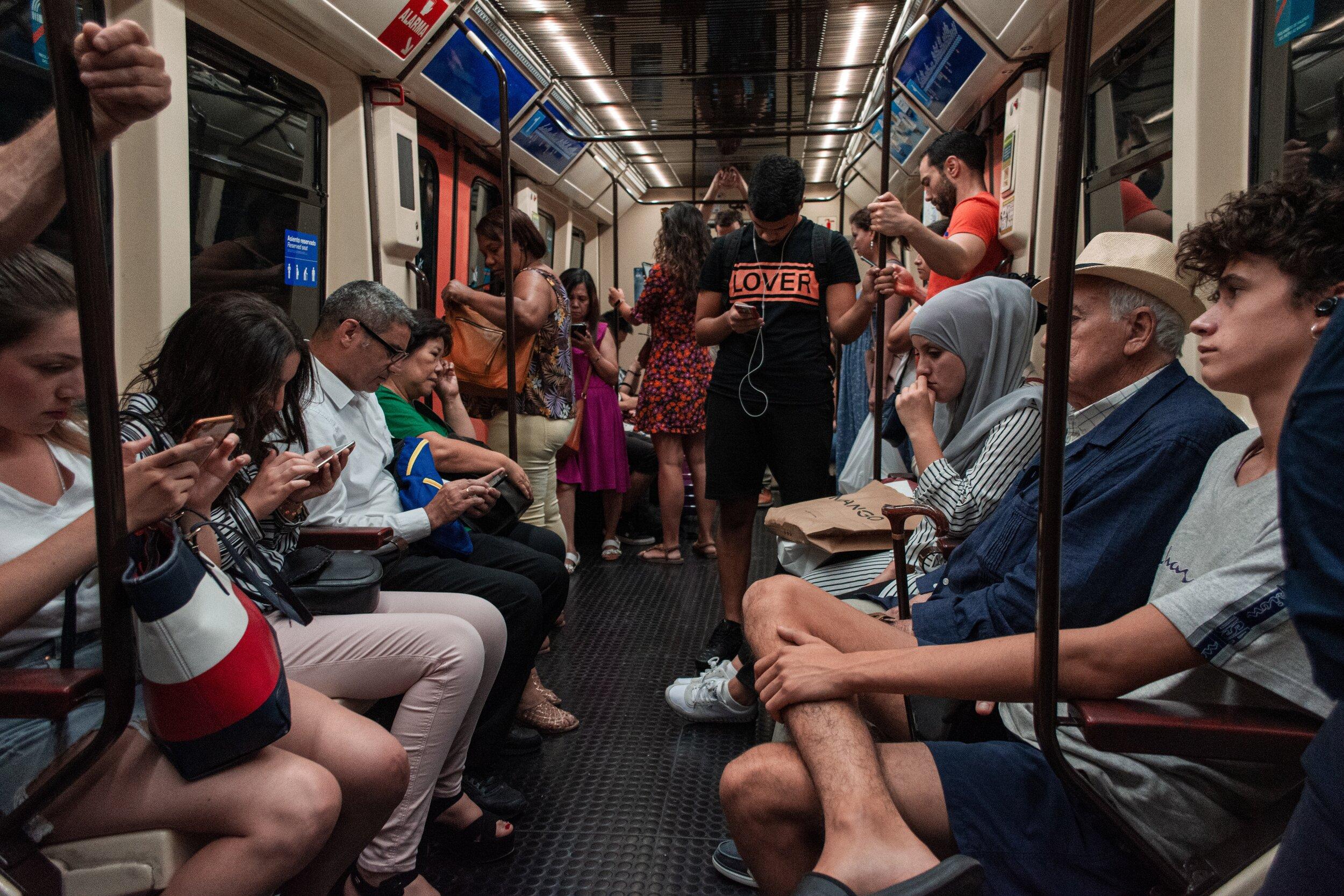 Auxiliares de conversación in Madrid taking the Metro to work teaching English