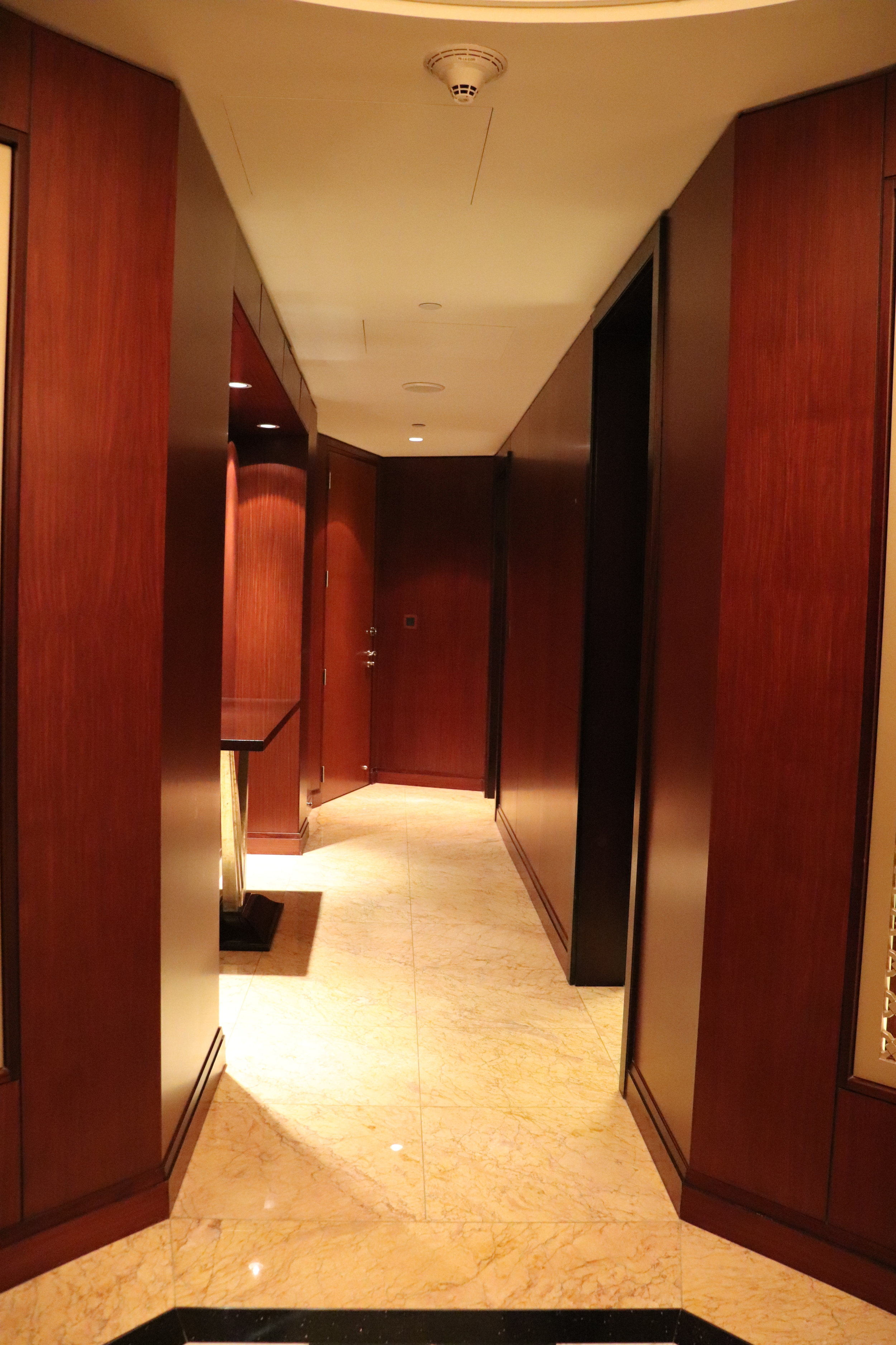 - The master bathroom and bedroom are the door on the right about midway down. There is also a second bathroom at the end of the hall on the right. The door to the left at the end of the hall was a connecting door to an adjoining suite.